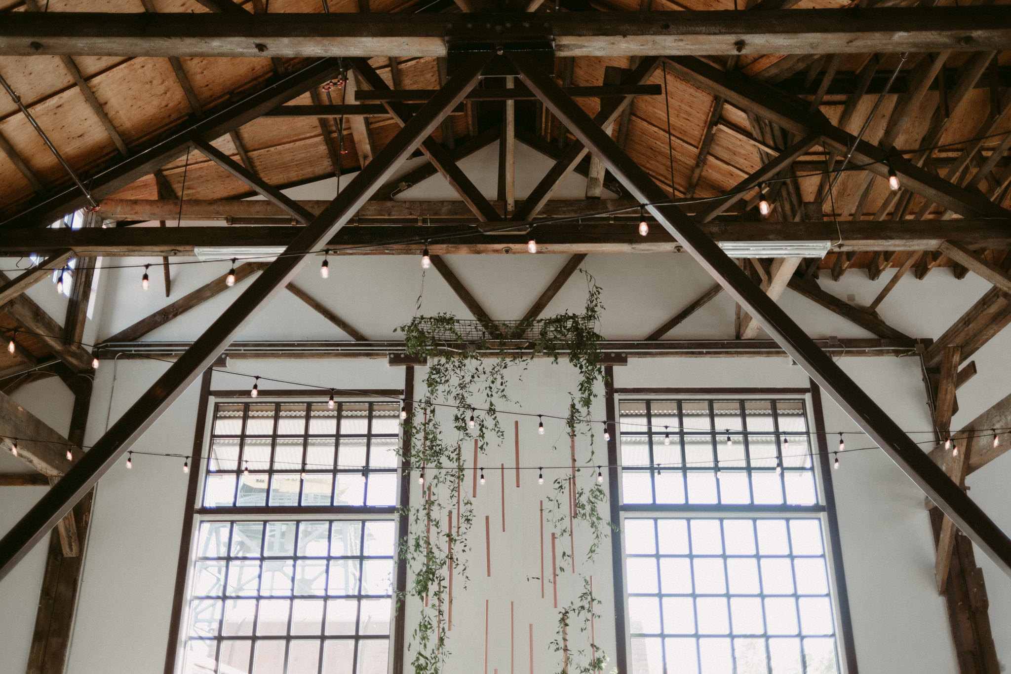 tall copper and vine backdrop installation at Pipe Shop wedding venue
