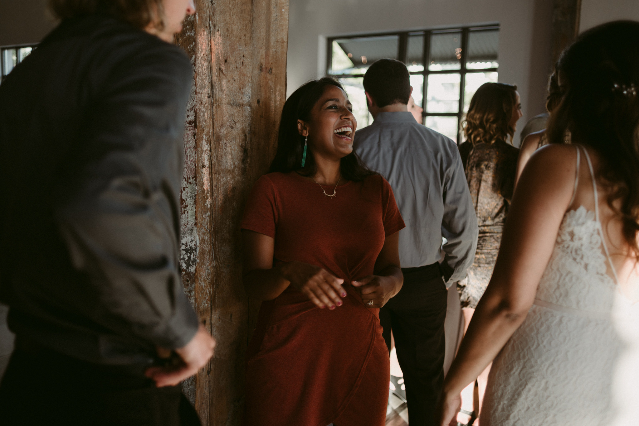 guests laughing during cocktail hour at wedding