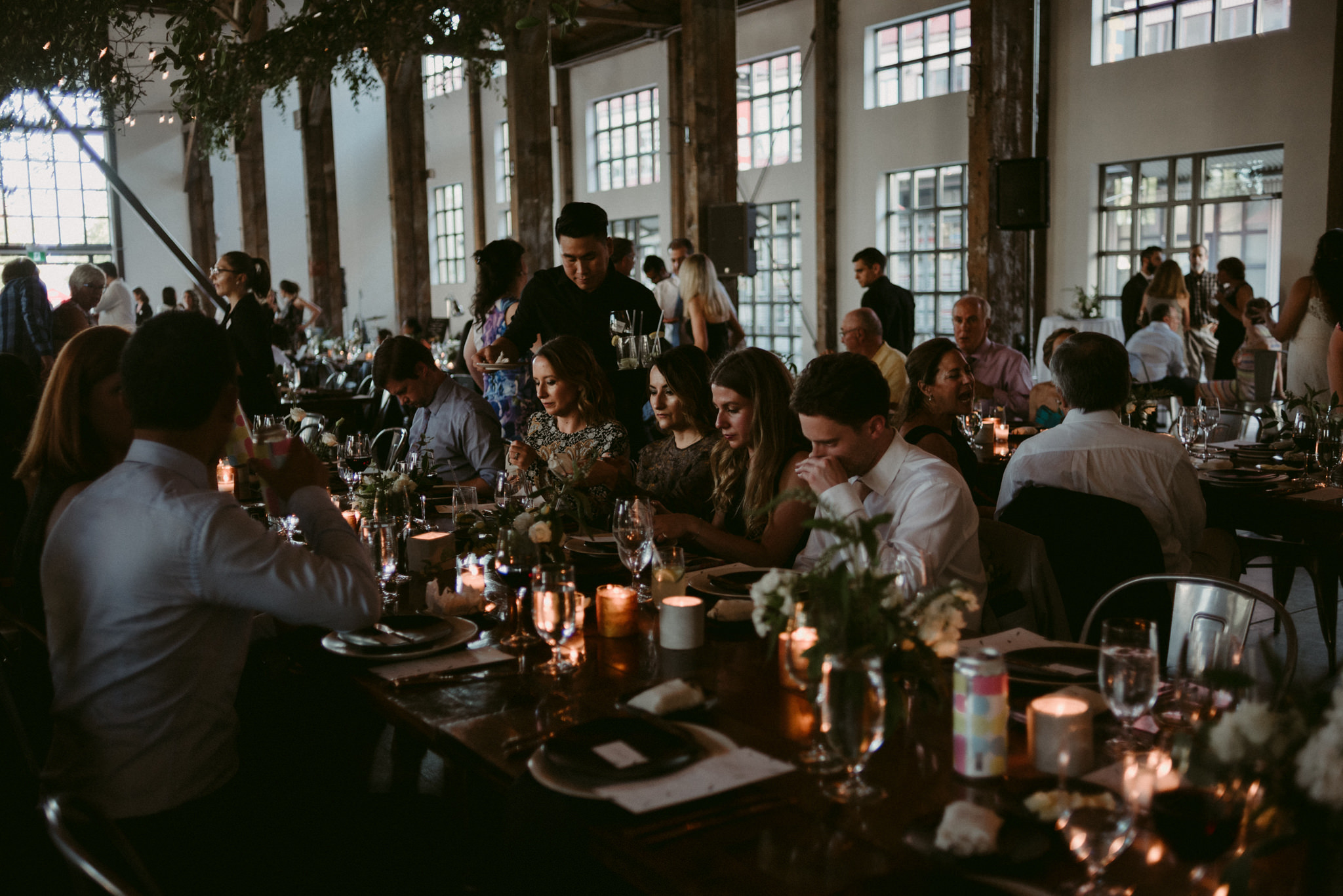 guests sitting at tables talking during wedding reception