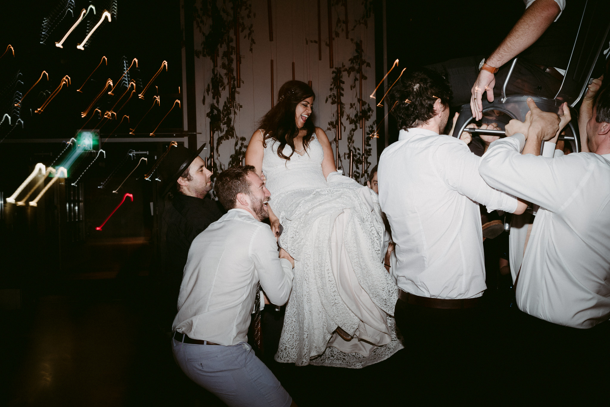 bride hoisted up in chair