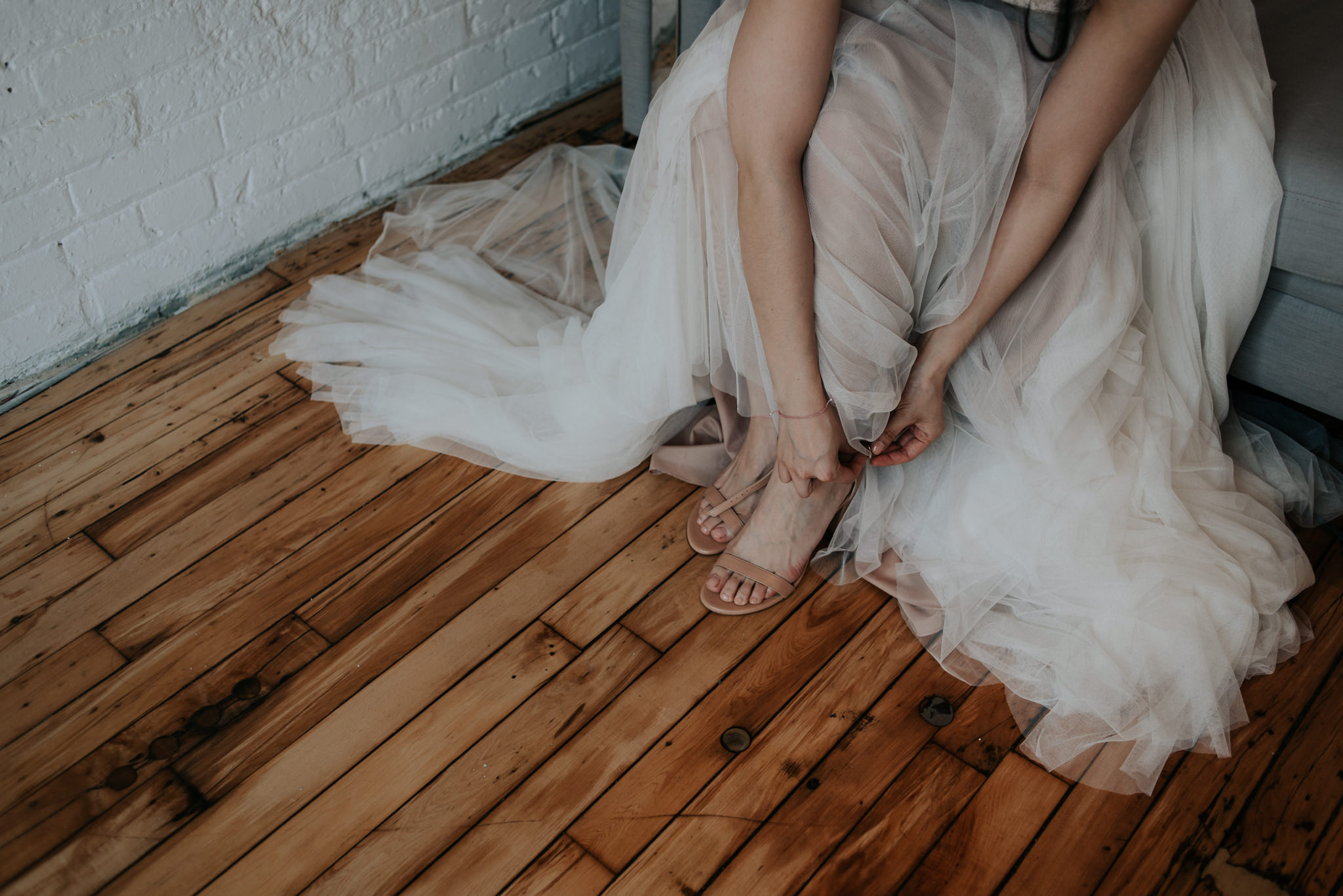bride against old brick wall in loft