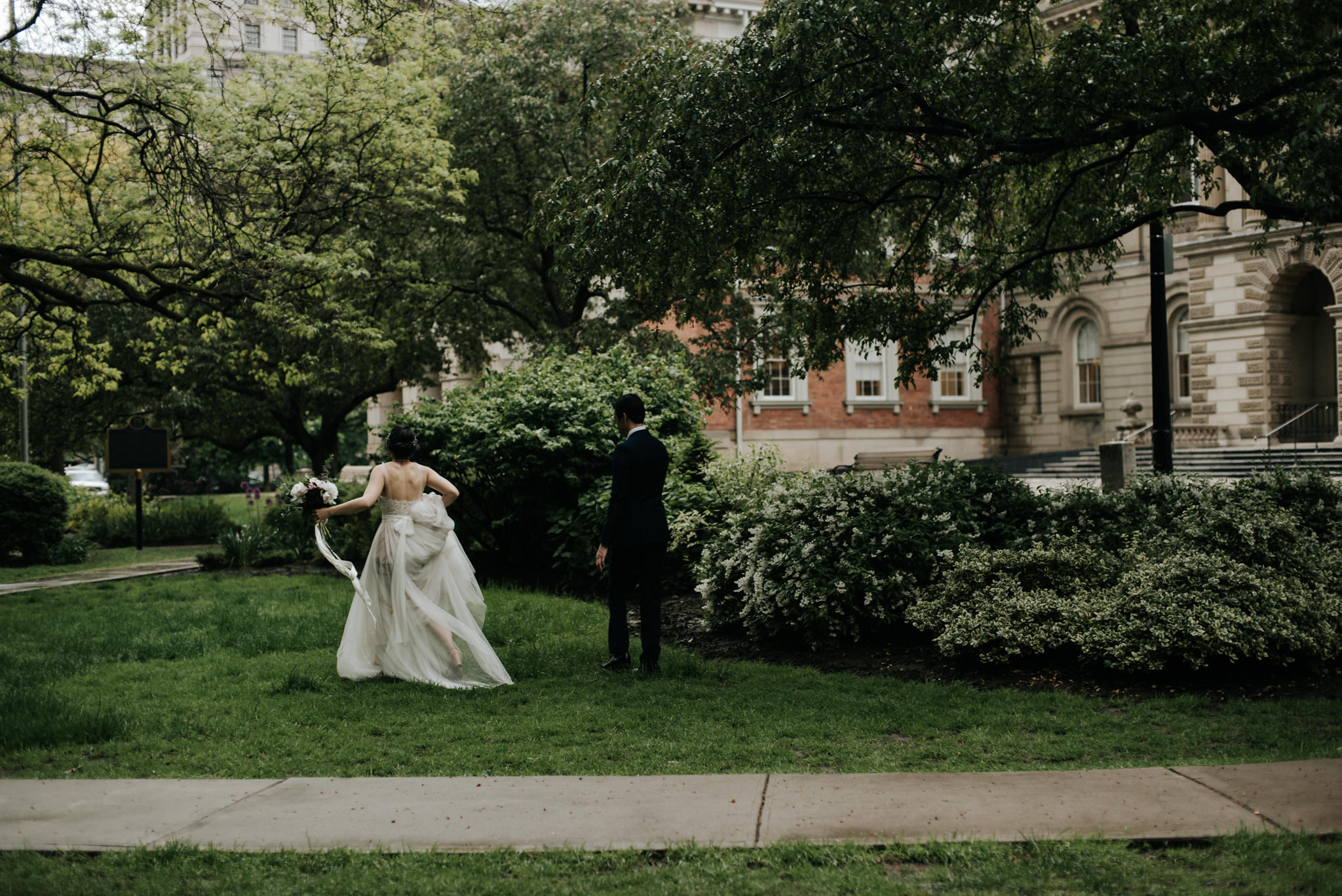 bride and groom in front of Osgoode Hall