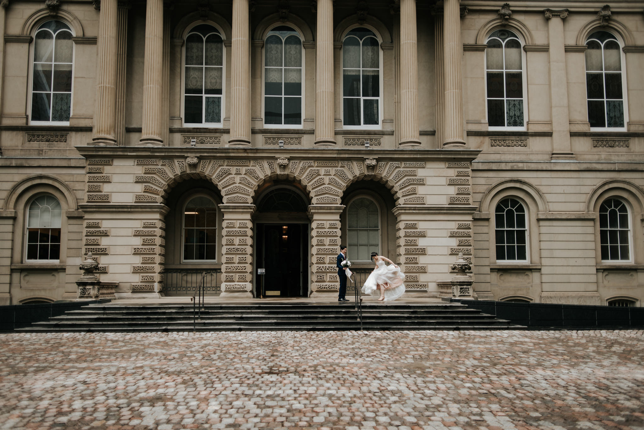 couple on wedding day in front of Osgoode Hall in Toronto
