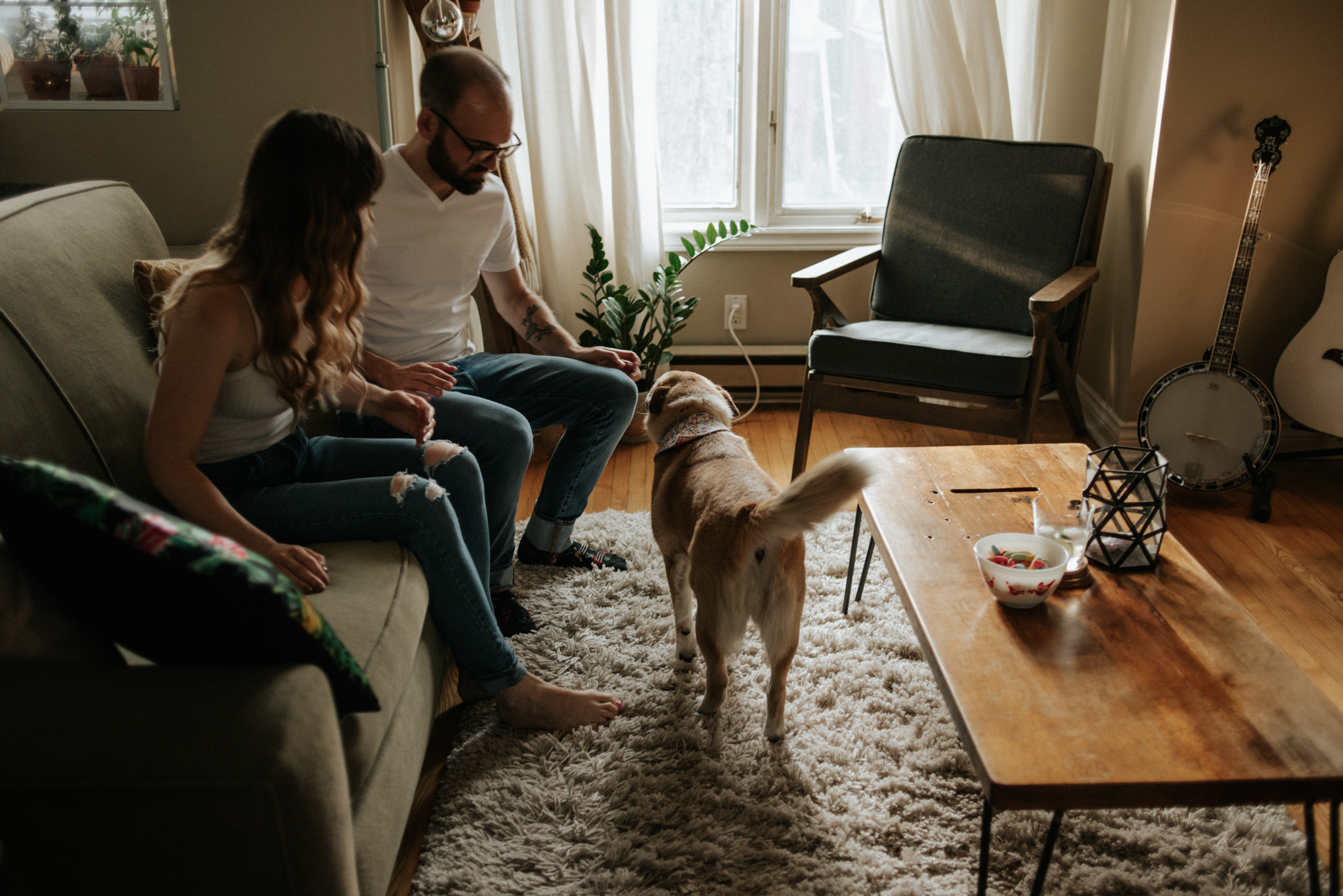 Couple with their dog in their apartment in Toronto
