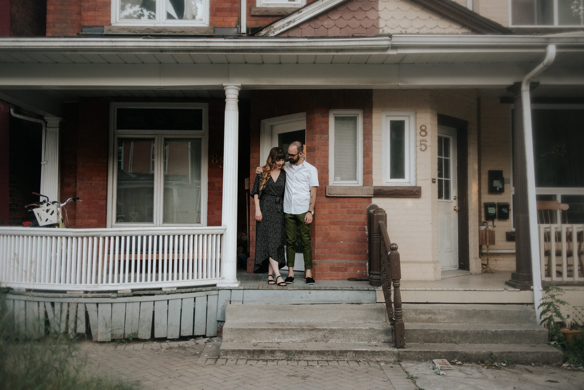 Couple standing in front of their home in Toronto