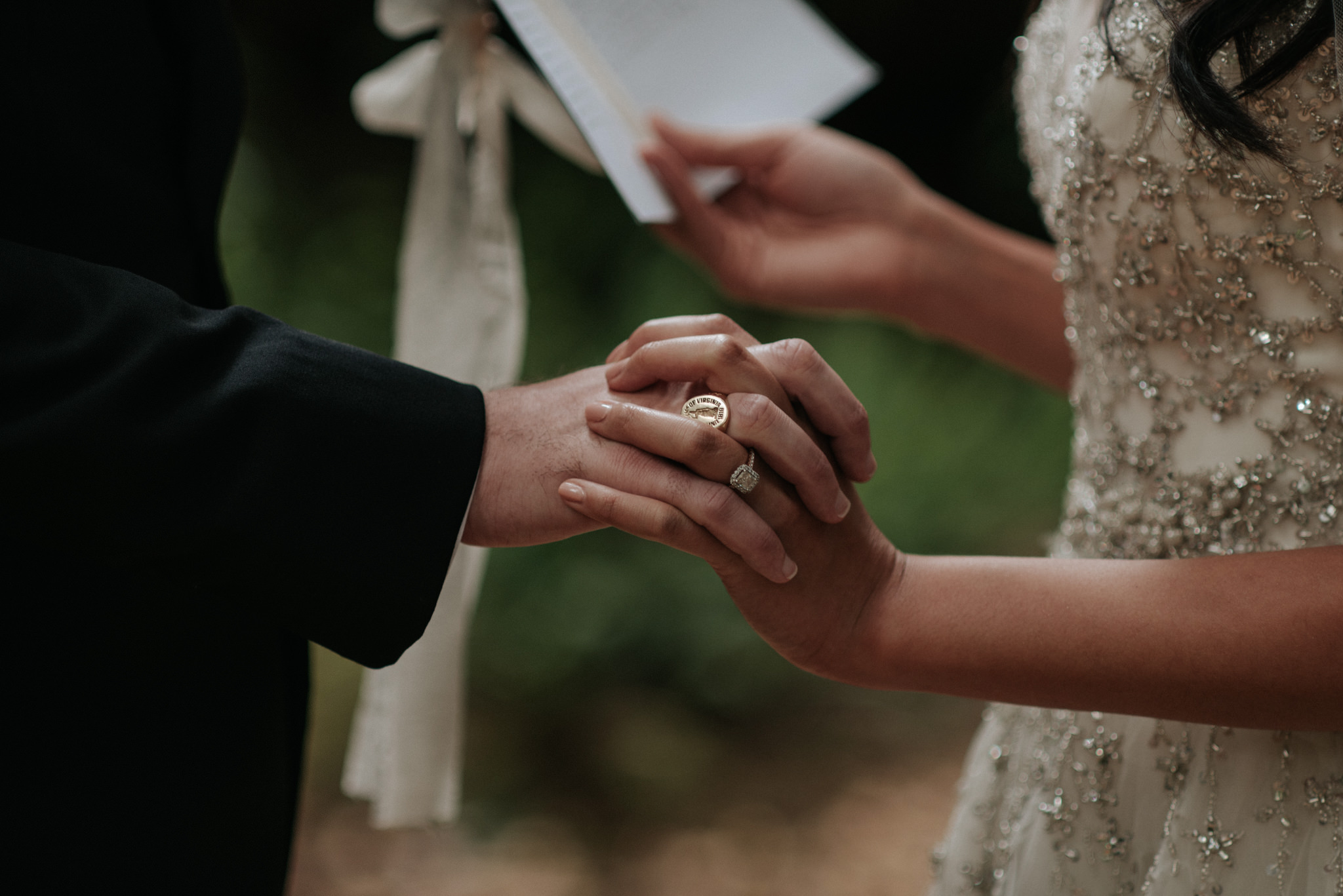 couple holding hands and reading vows to each other
