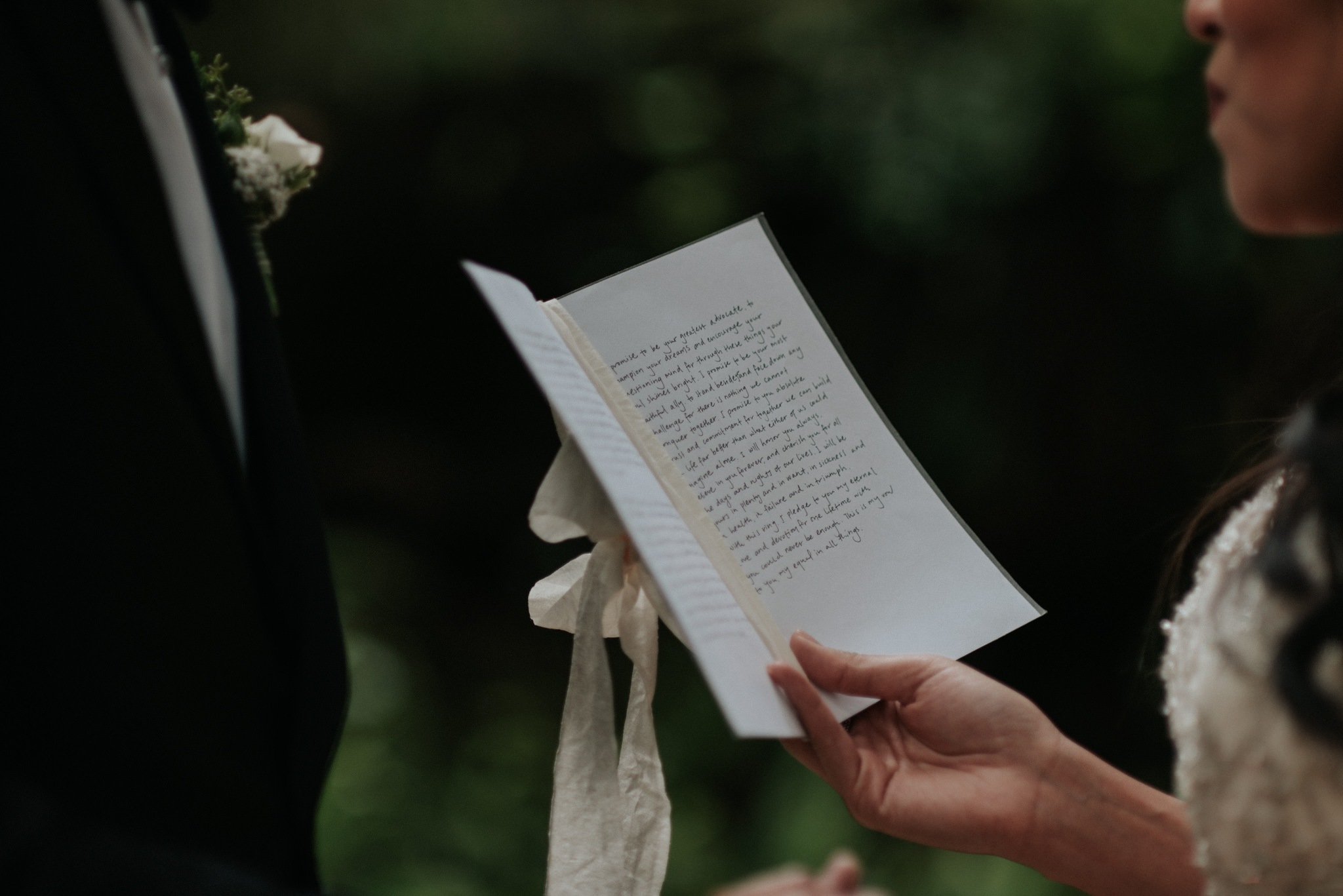 couple reading vows to each other