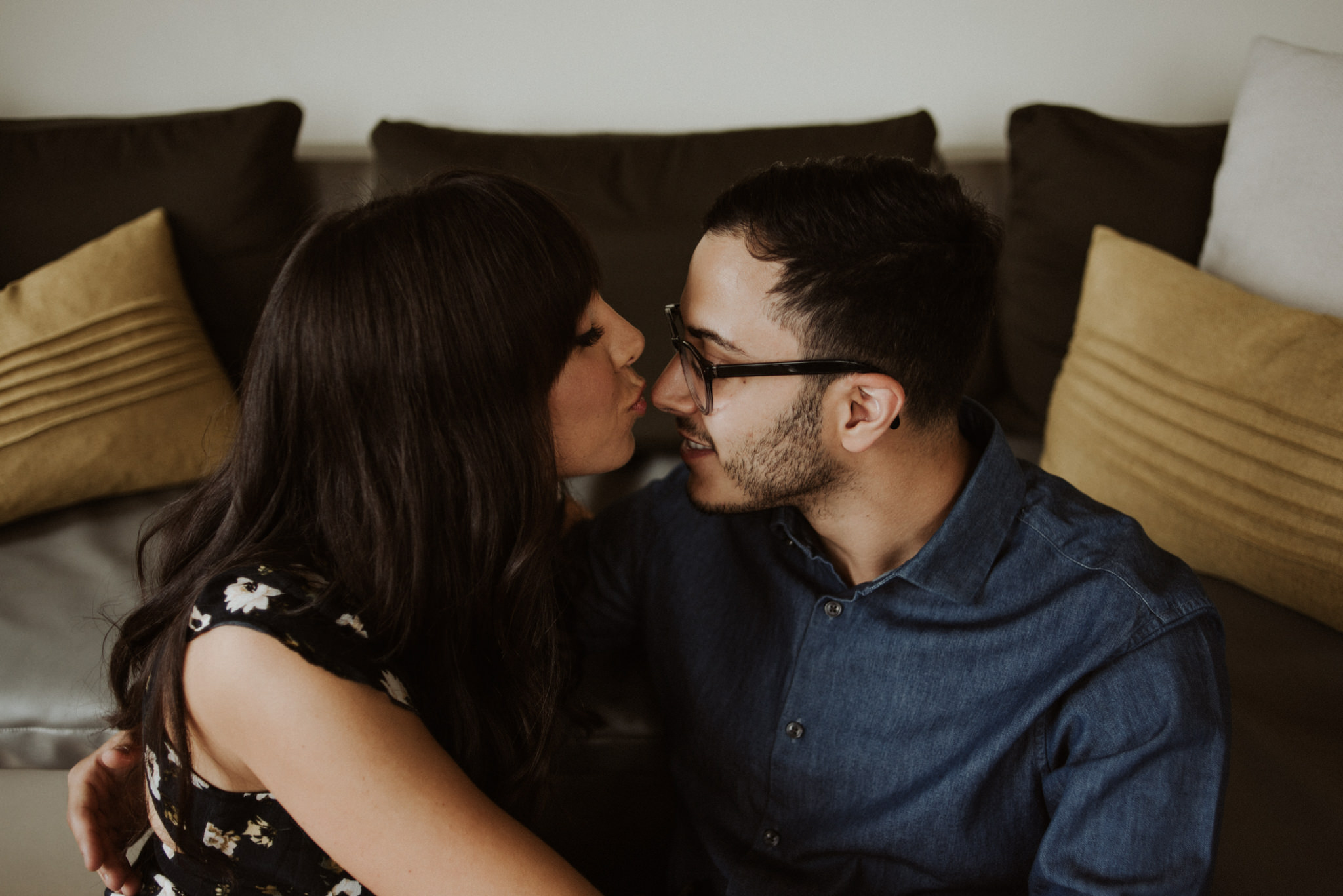 girl kissing guys nose in living room
