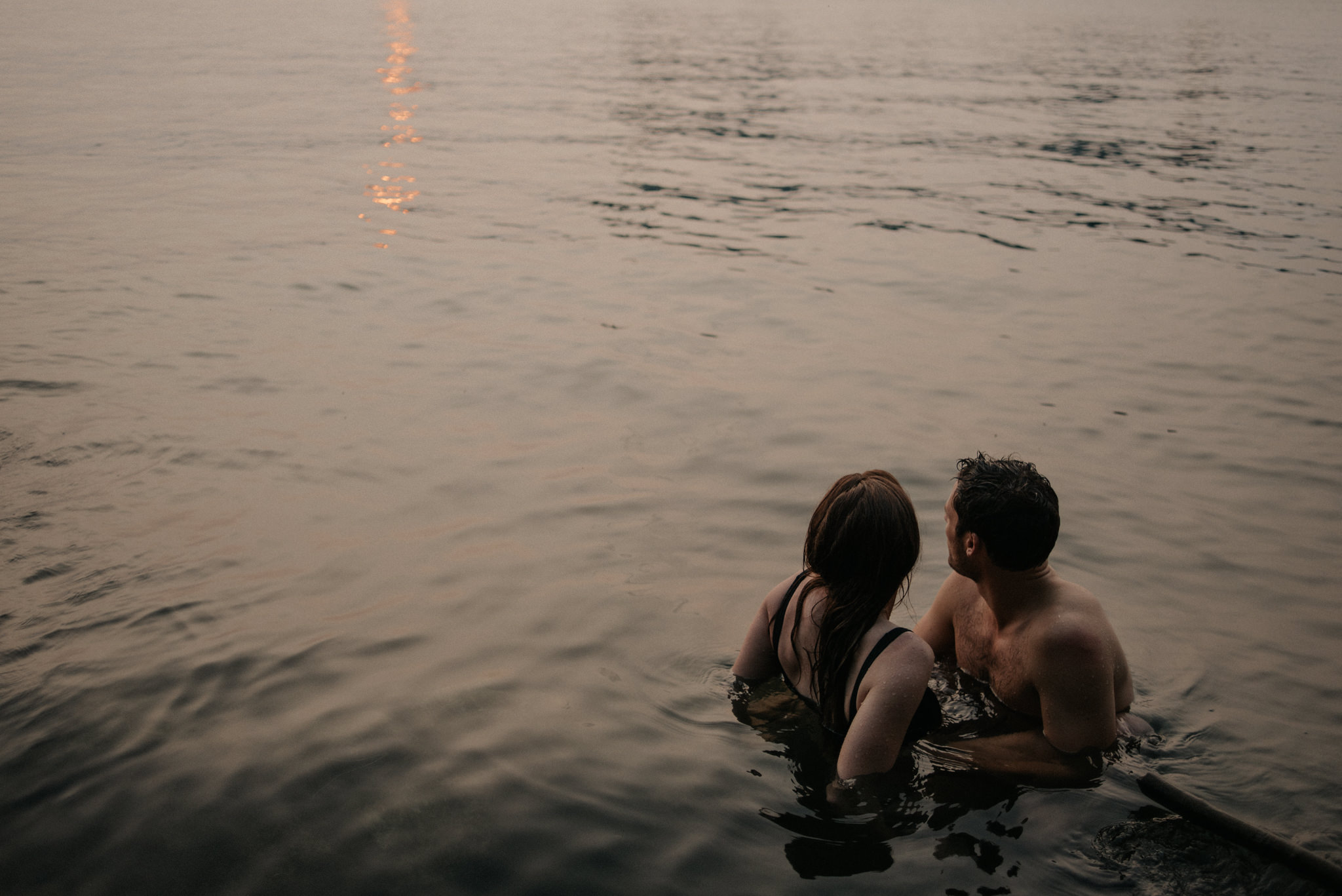 Couple in water overlooking Toronto