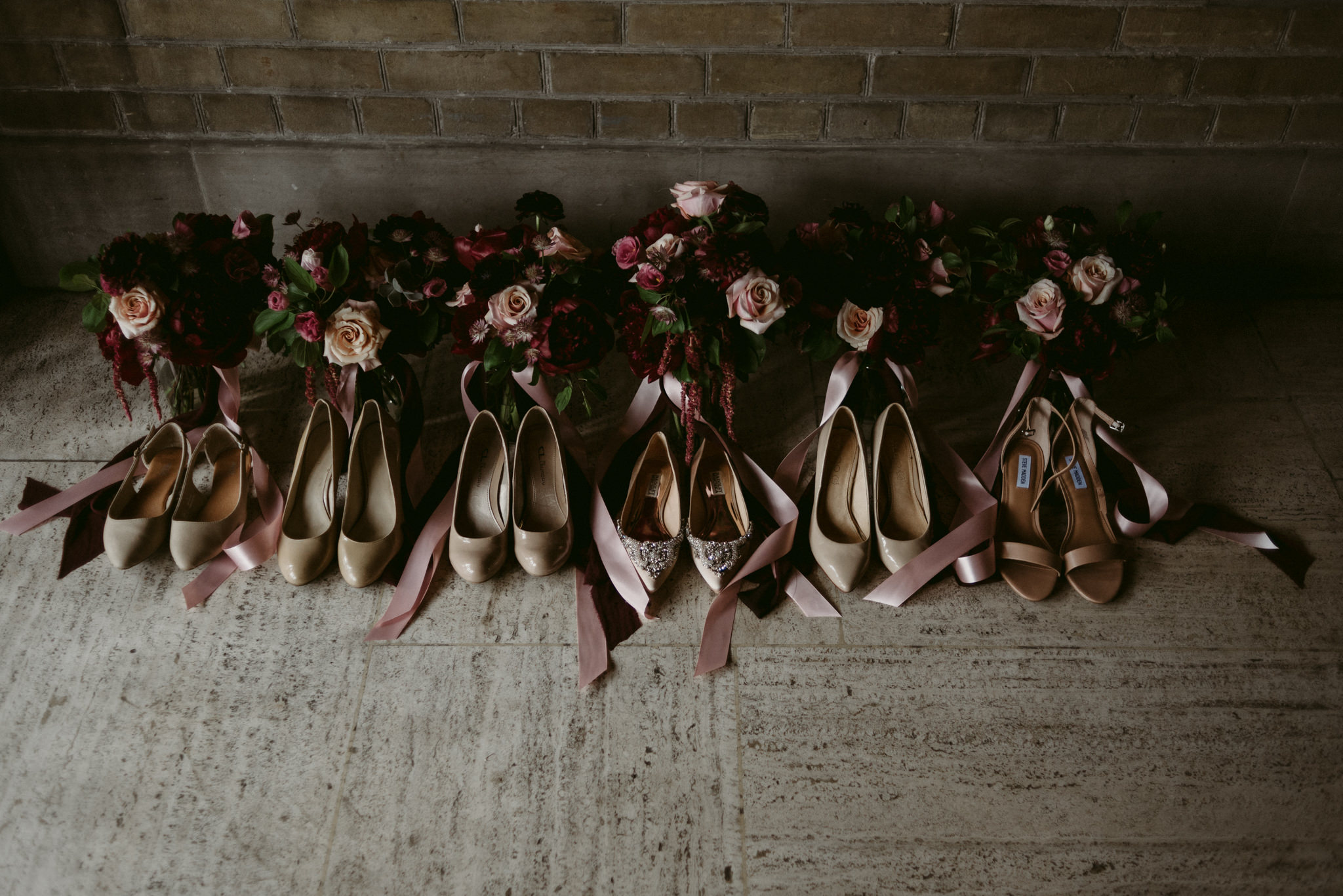 bridesmaids shoes and bouquets on the floor