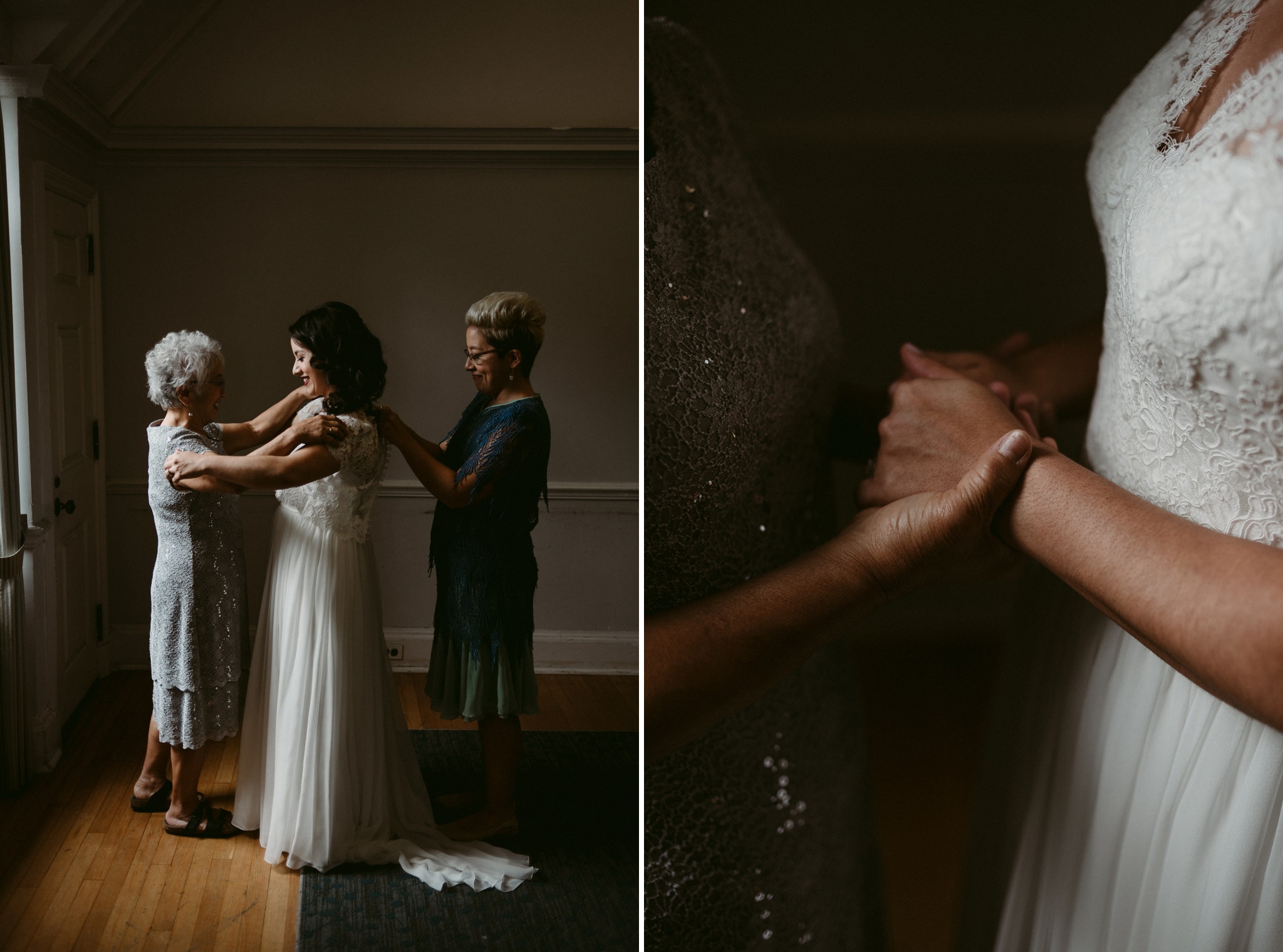 mother and sister helping bride into dress