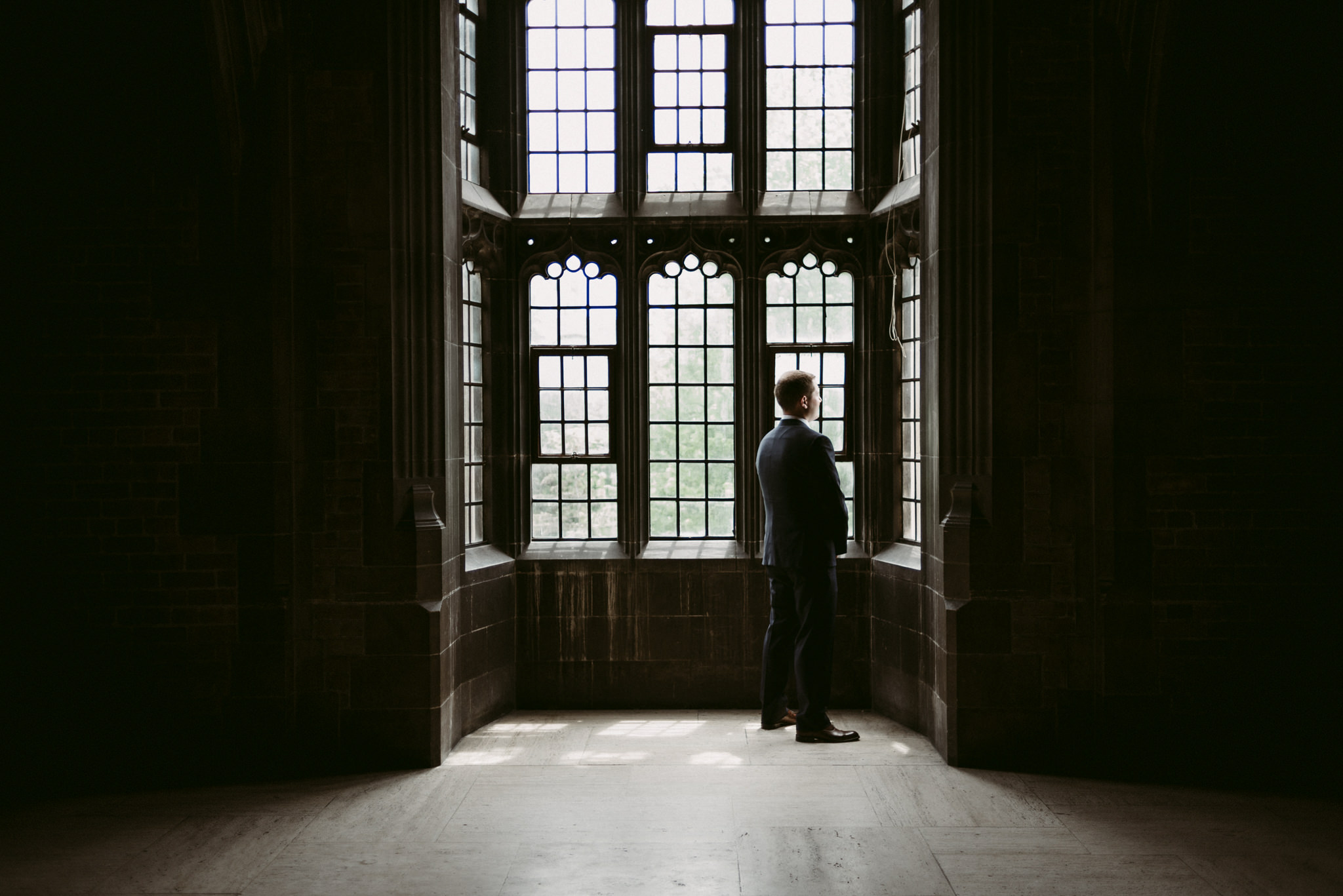 Groom waiting for first look in Hart House