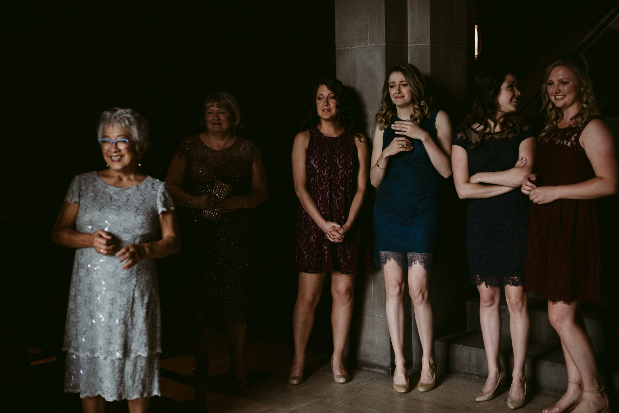 bridesmaids and mother of bride watching during first look at Hart House wedding
