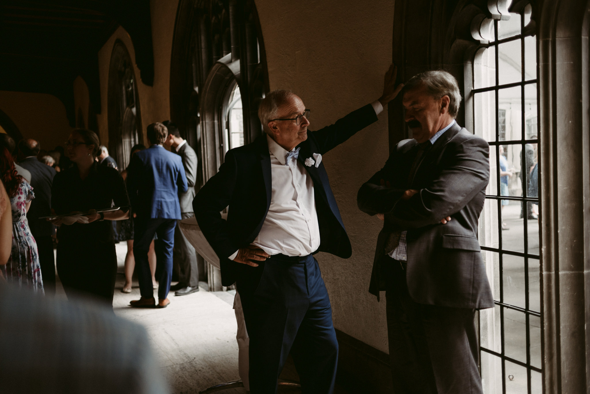 Guests talking during cocktail hour at Hart House Wedding