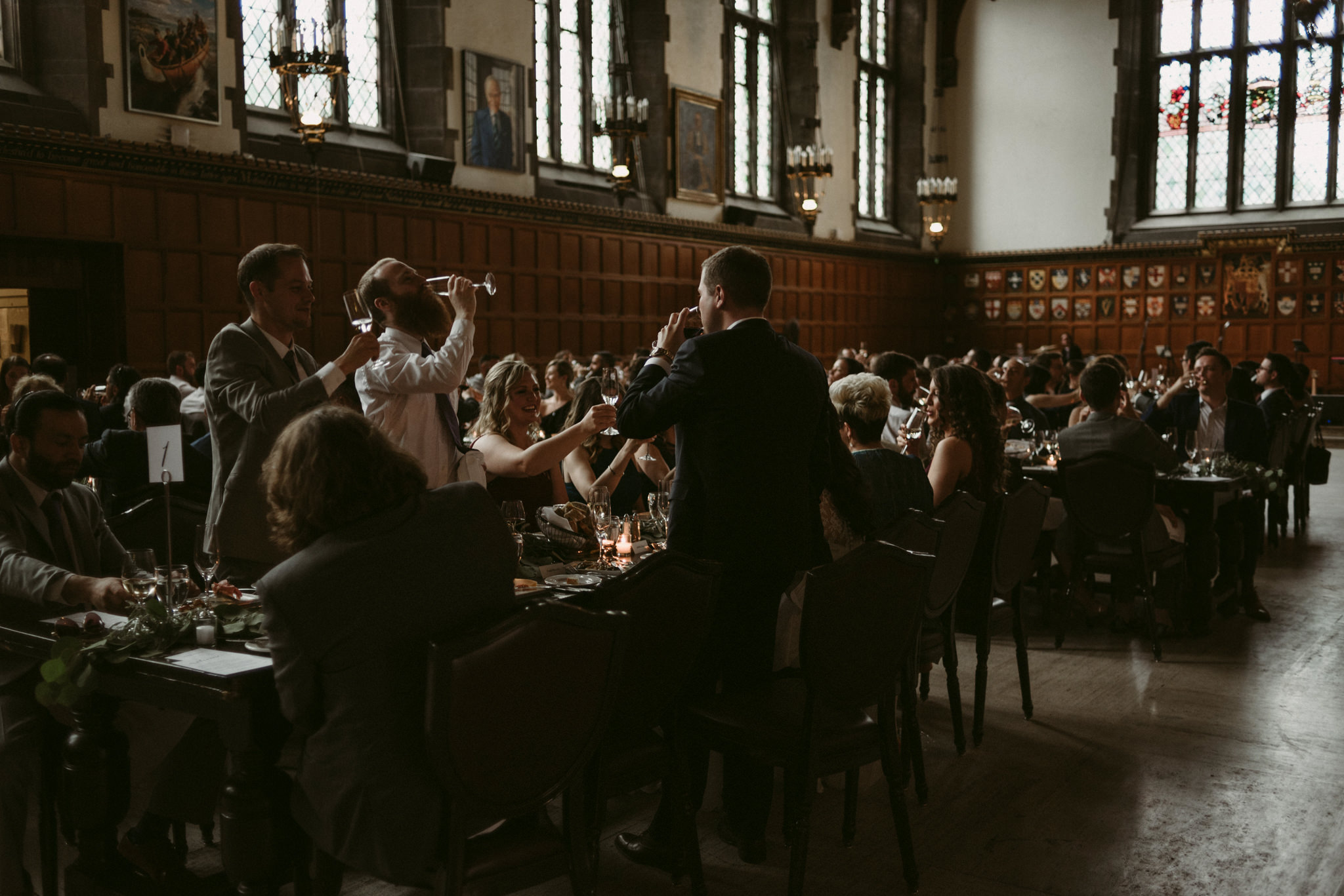 Groom and groomsmen drinking during wedding reception at Hart House