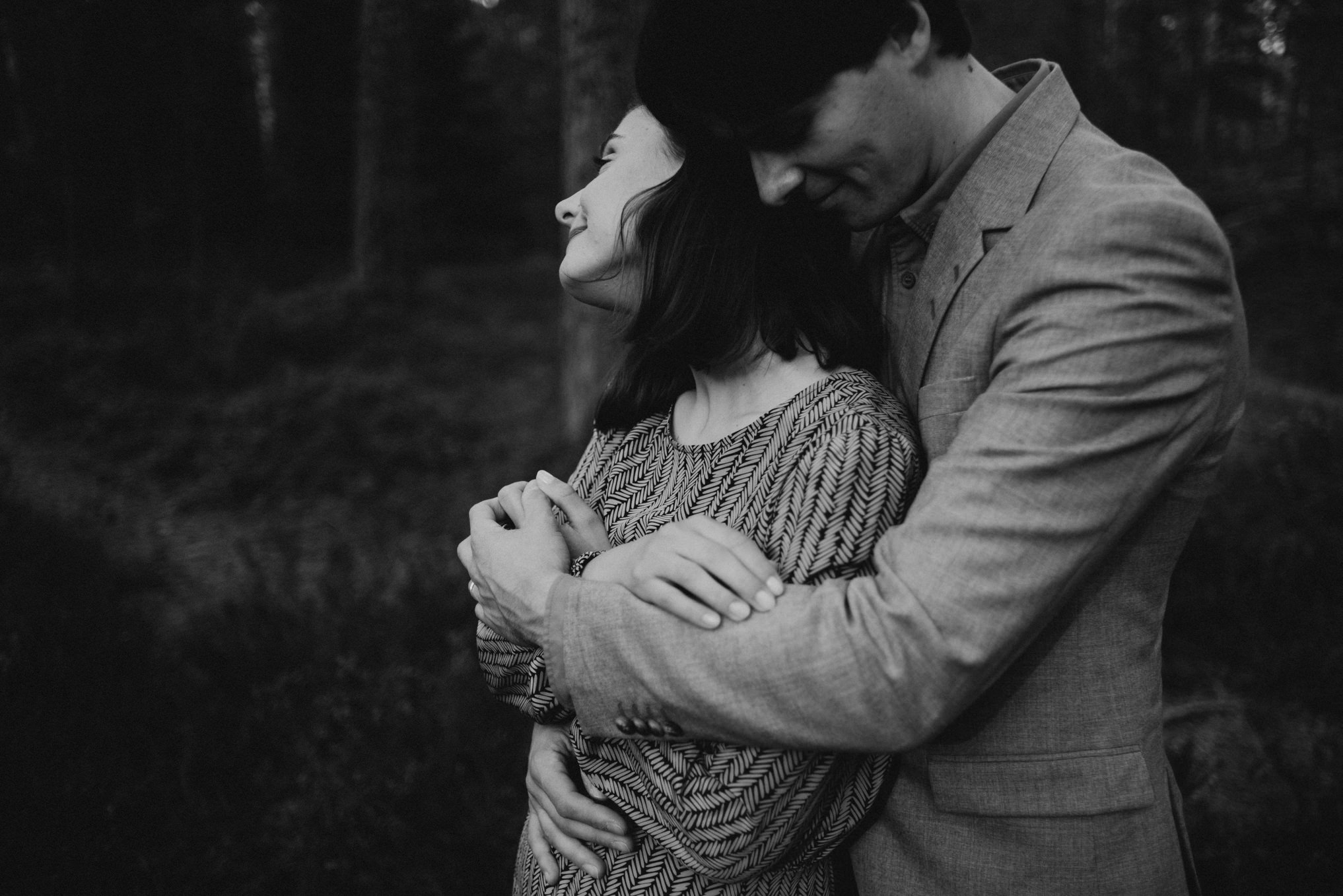 black and white image of couple hugging