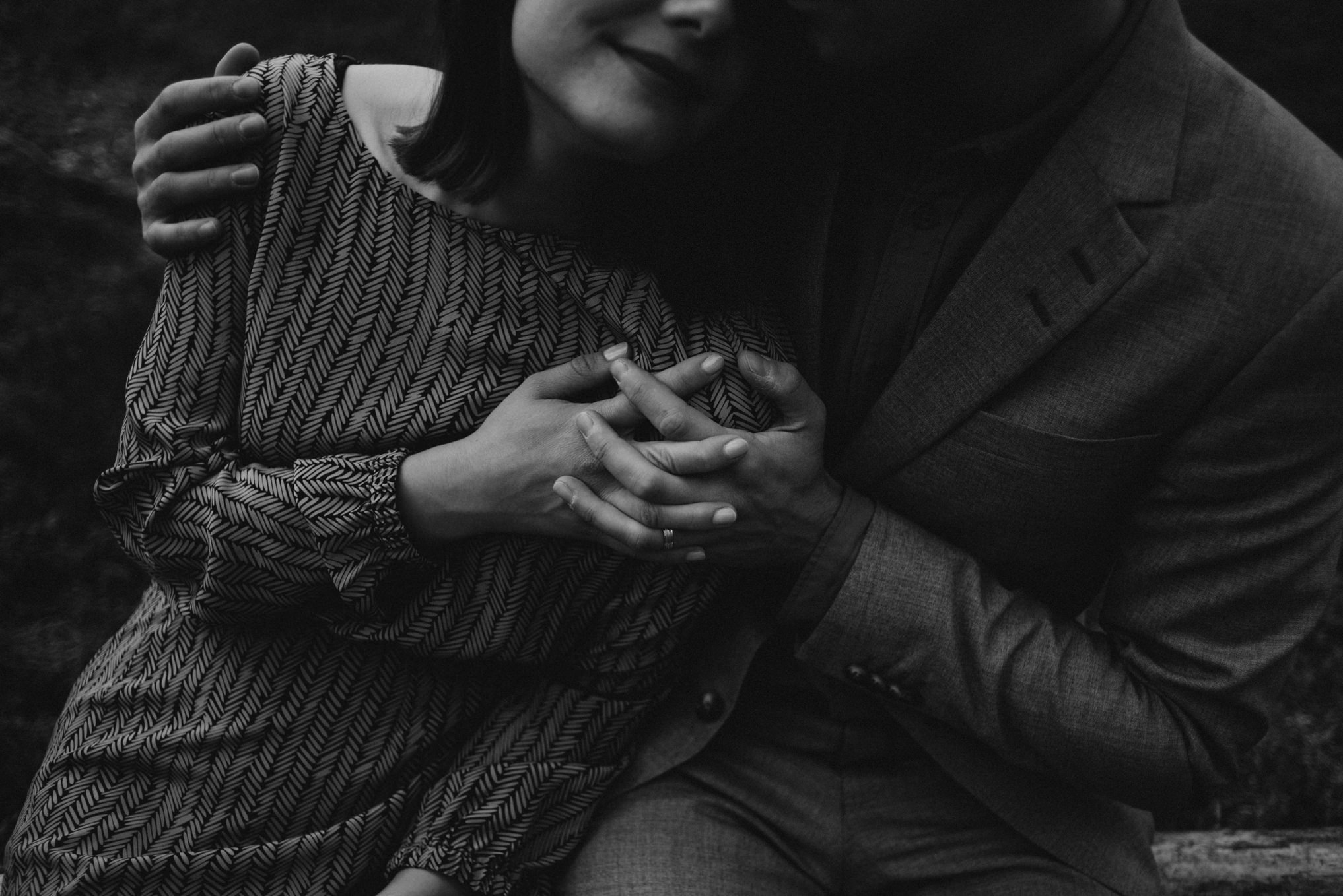 black and white image of close-up of couple holding hands