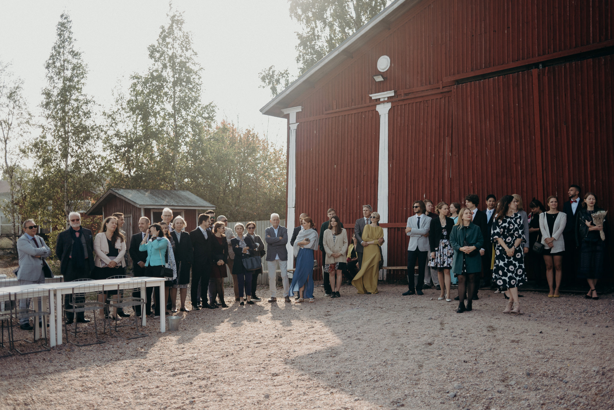 Guests watching during wedding ceremony at Valkosaaren Telakka