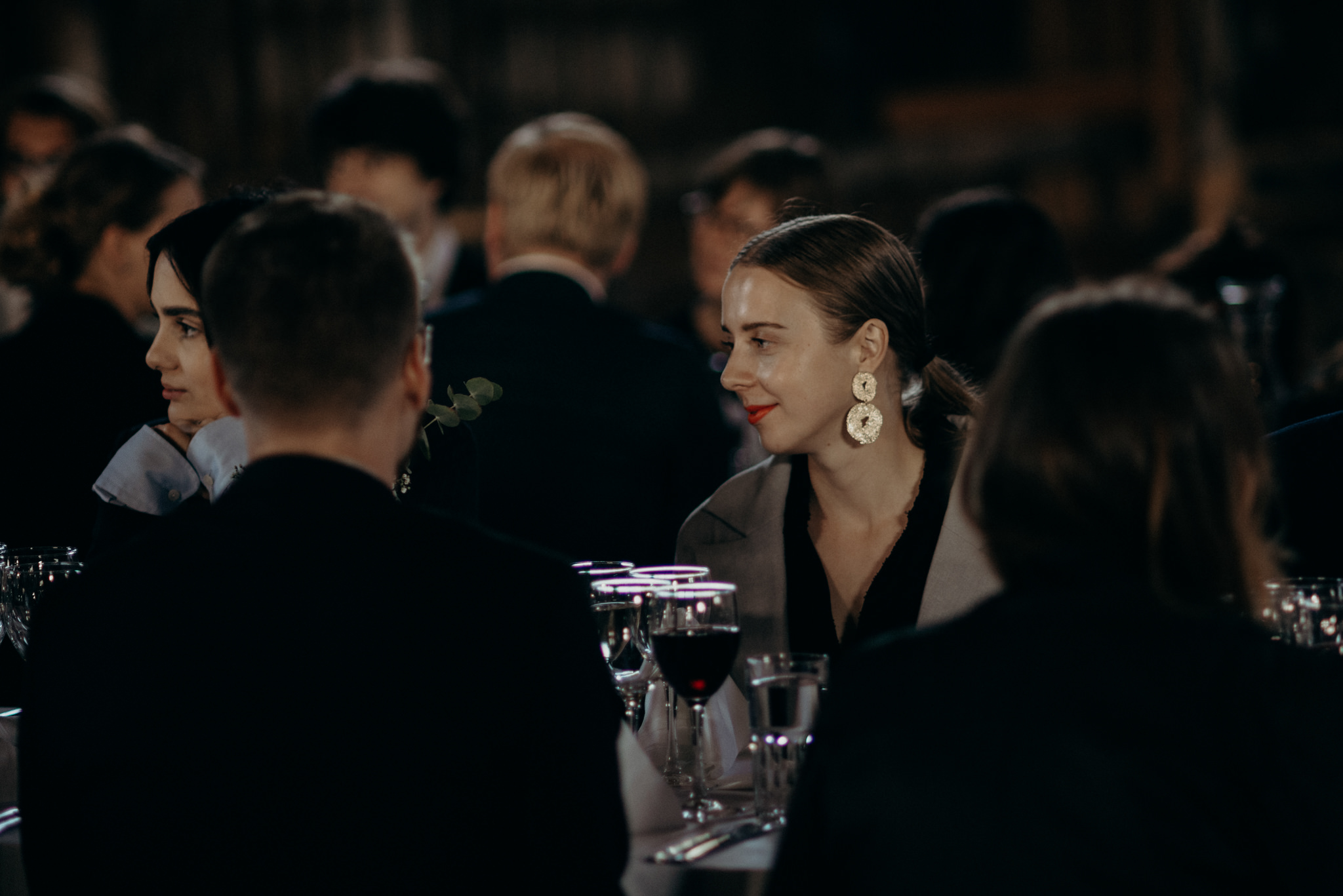 Guests listening during speeches at Valkosaaren Telakka wedding reception