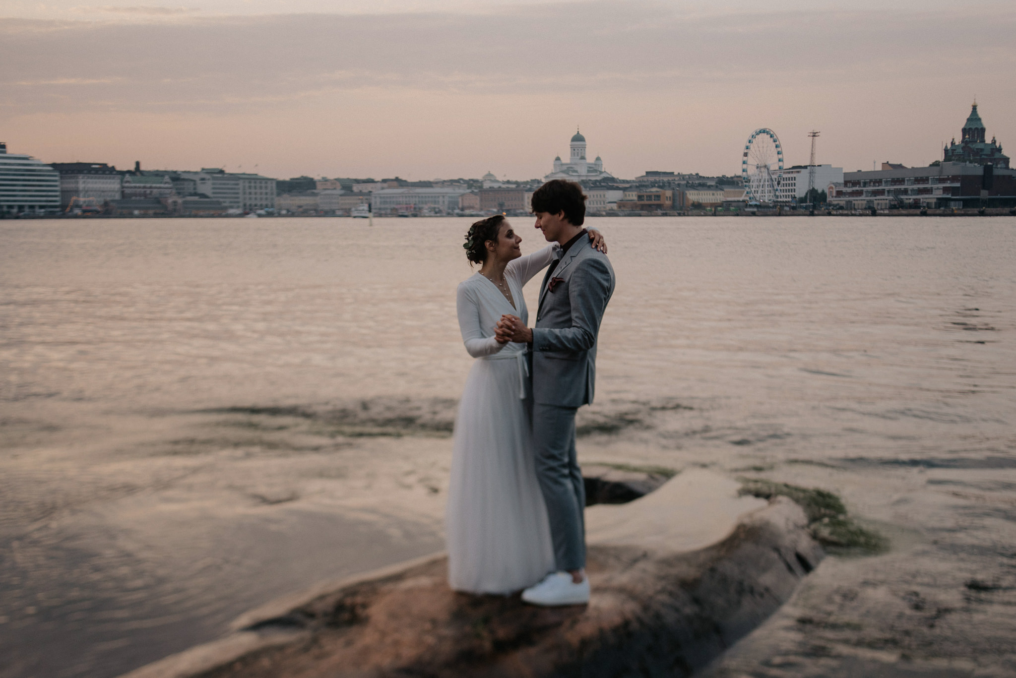 Wedding portraits overlooking Helsinki from Valkosaari at sunset