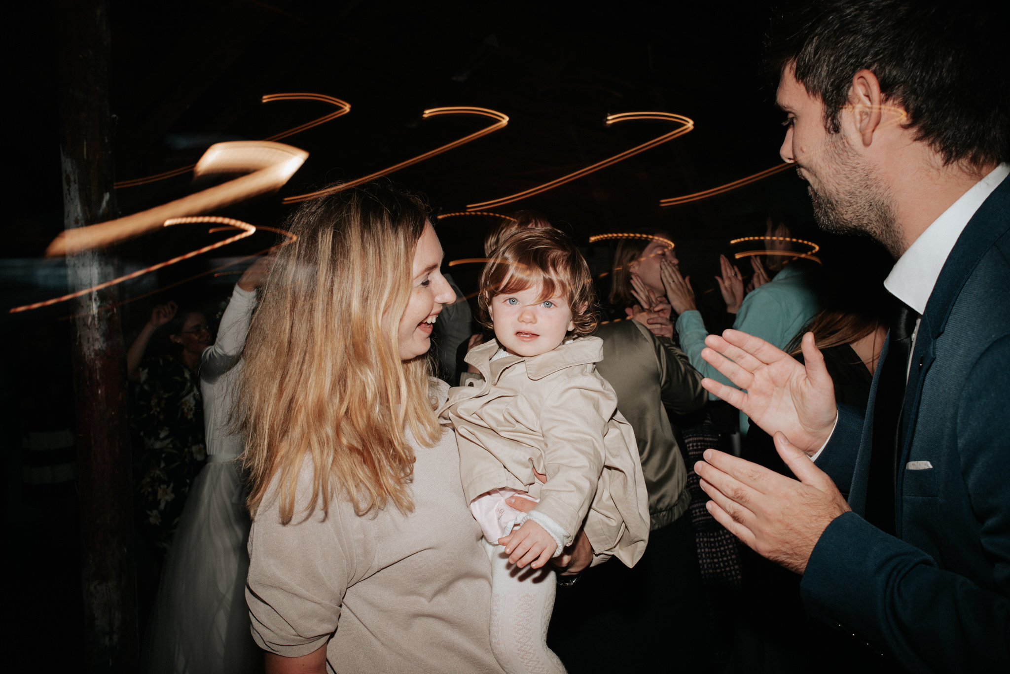 guests with baby dancing during wedding reception