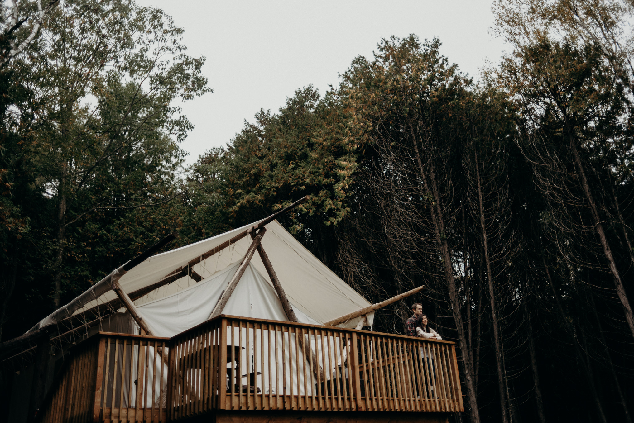 couple standing in front of glamping tent