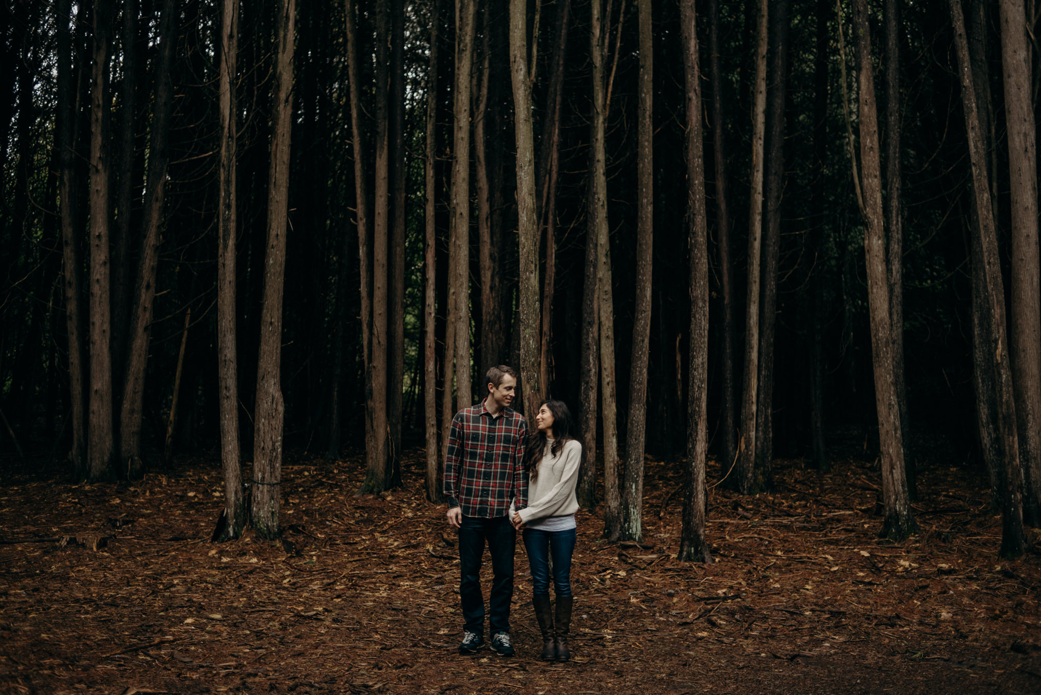 couple hugging in the forest, fall couple shoot