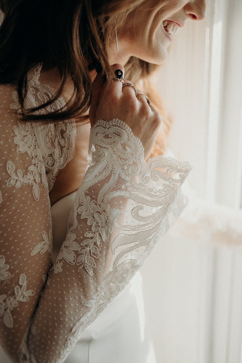 close up of details on long sleeve wedding dress