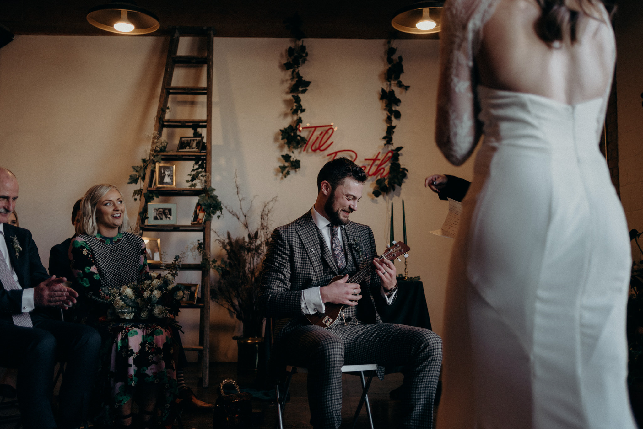 groom playing ukelele