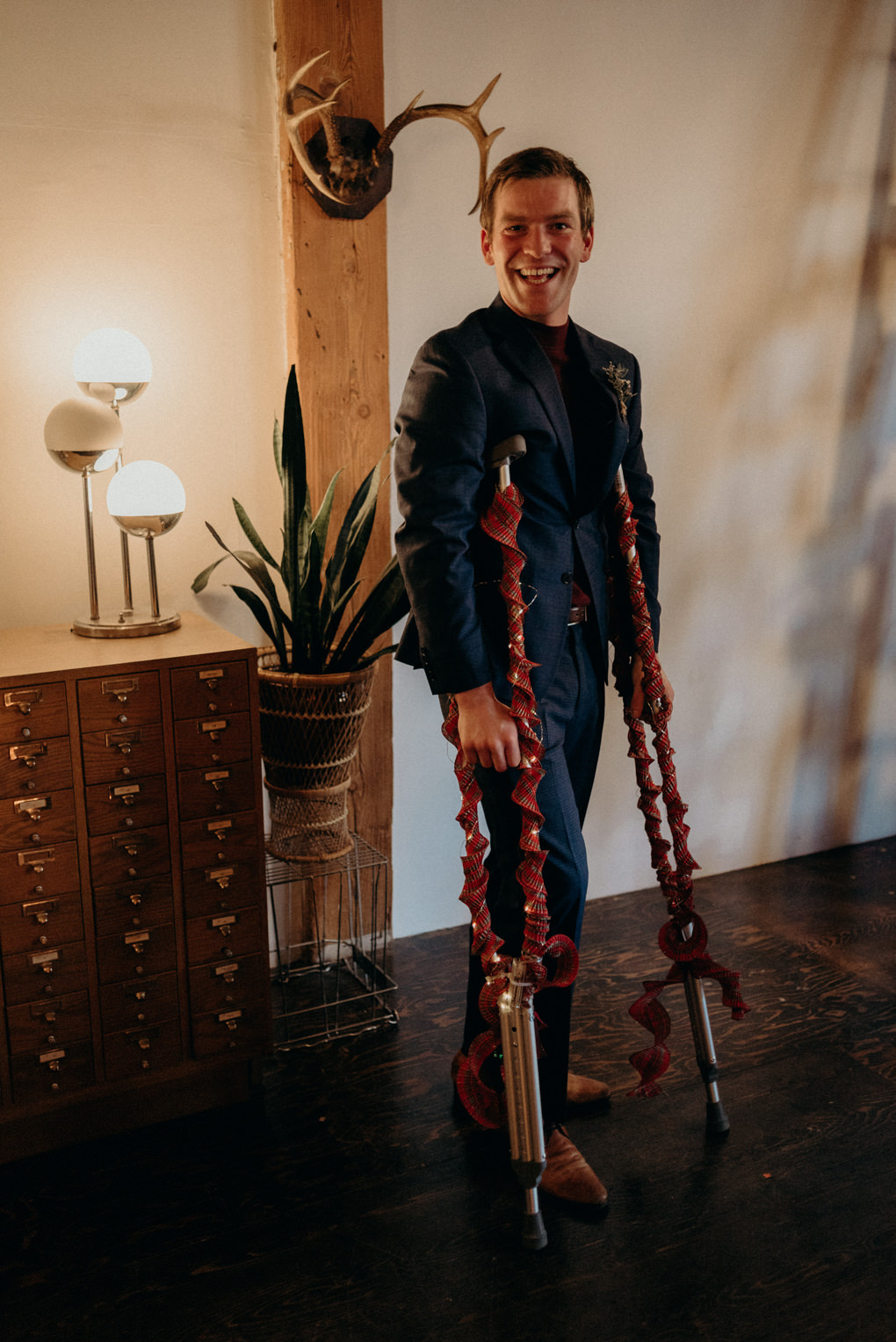 guest with crutches at wedding