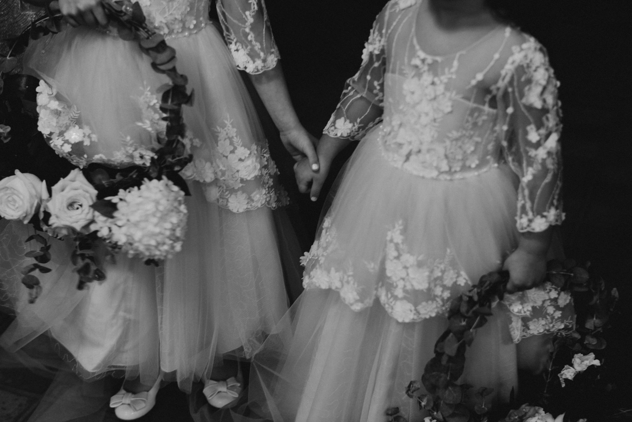 flower girls holding hands