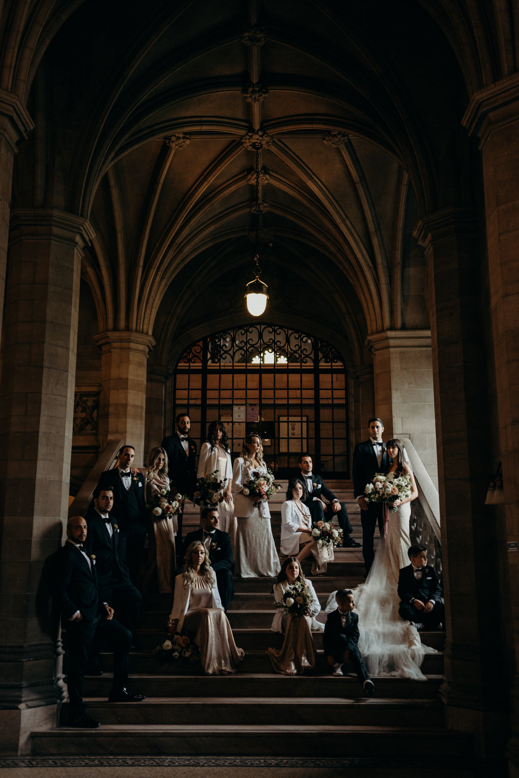 Dramatic and vogue inspired wedding party portrait inside Knox College