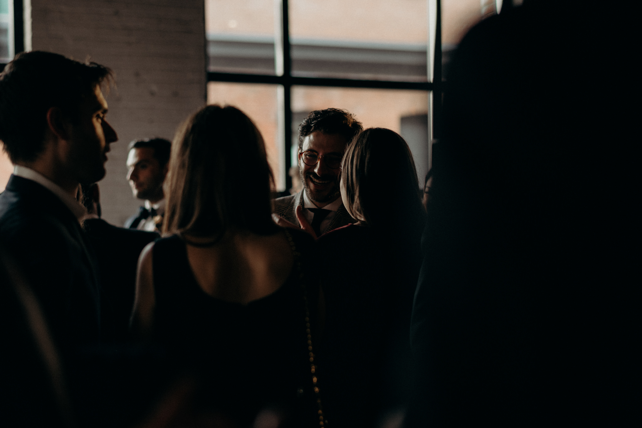 guests mingling during cocktail hour at Storys Building wedding