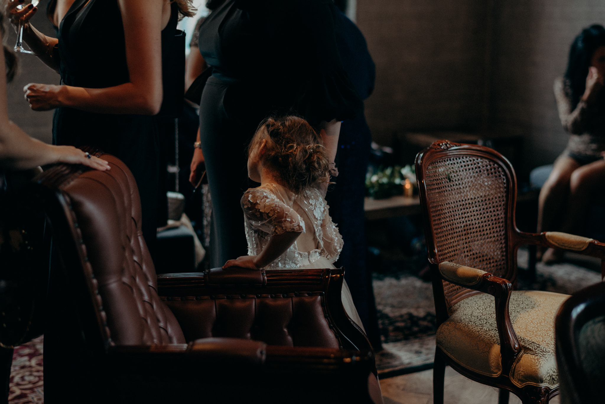 flower girl holding her mom's hand during cocktail hour