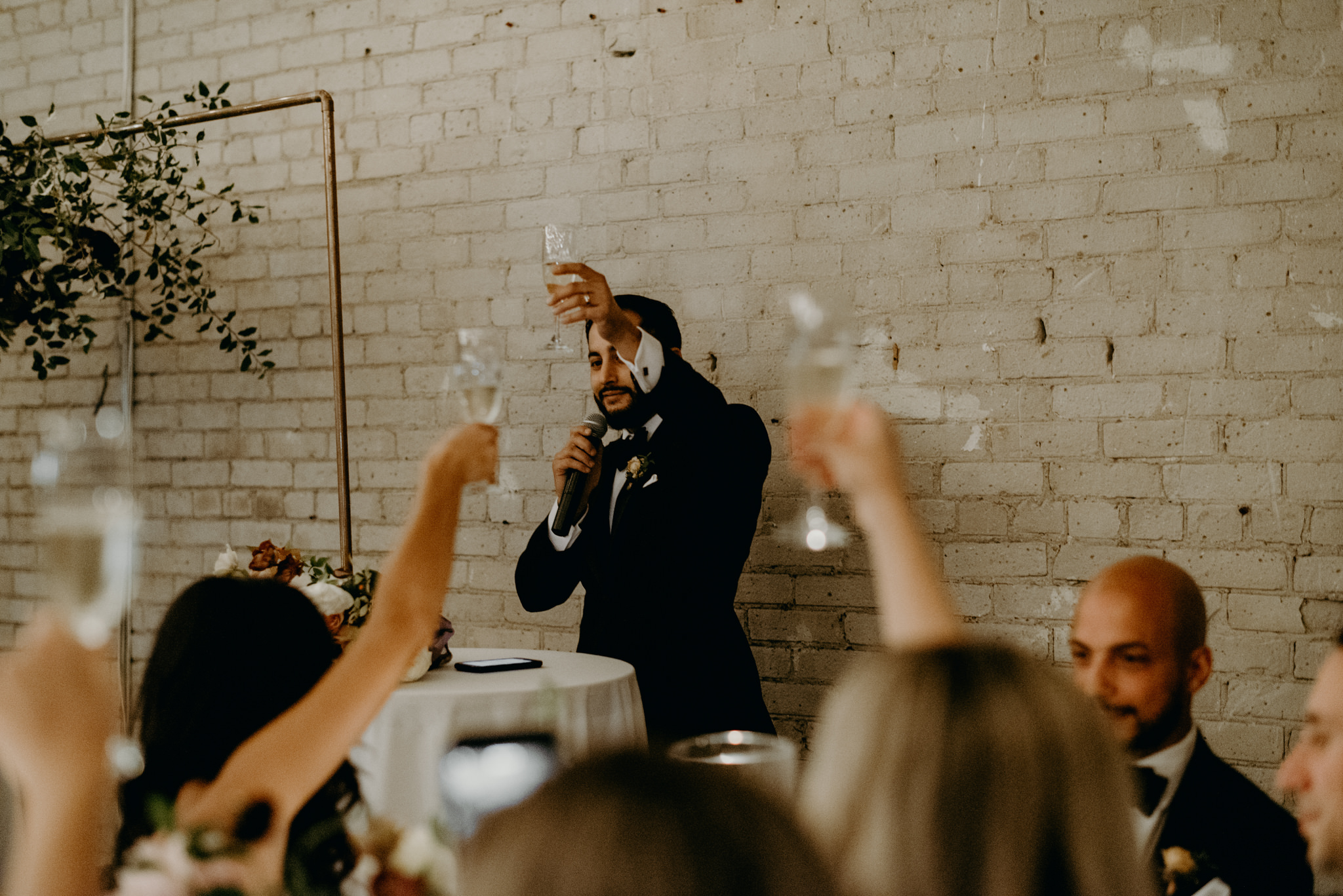 Best man speech toasting during wedding reception