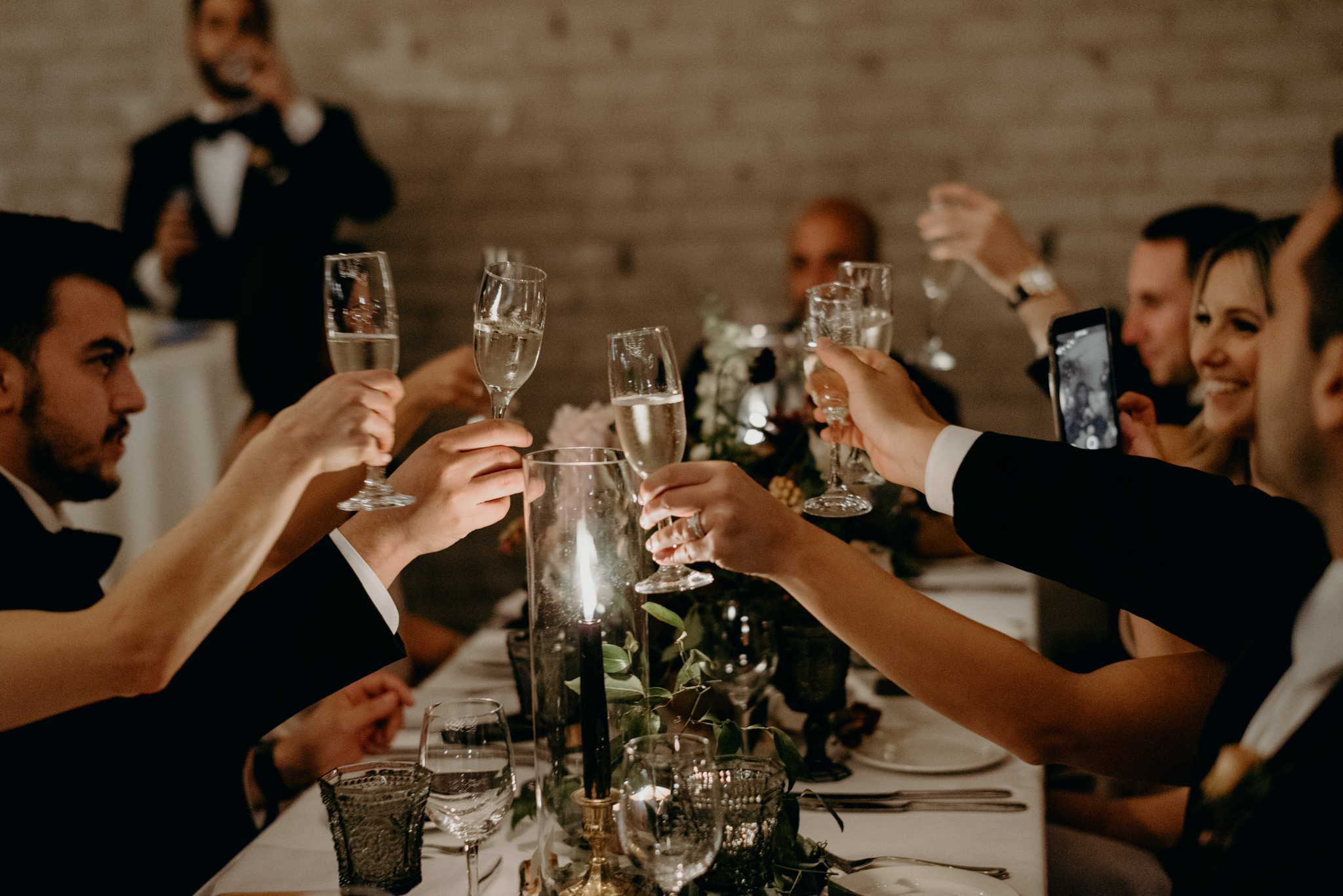 Guests clinking glasses during at Storys Building wedding reception