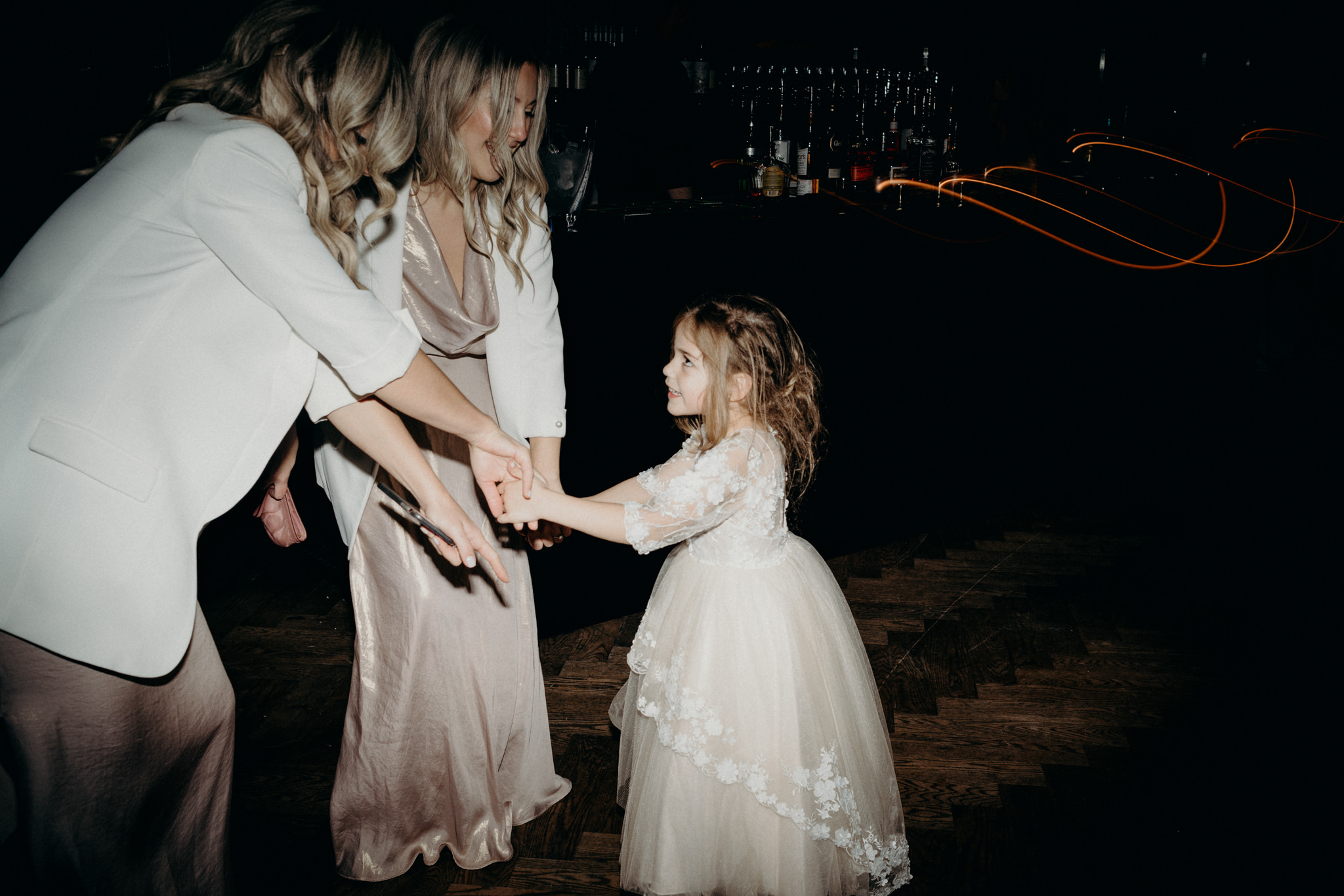 bridesmaids dancing with flower girl during wedding reception at Storys Building