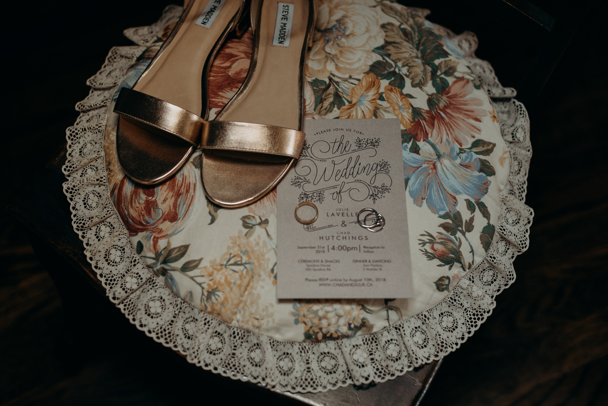 wedding invitation, rings and shoes on vintage floral round pillow