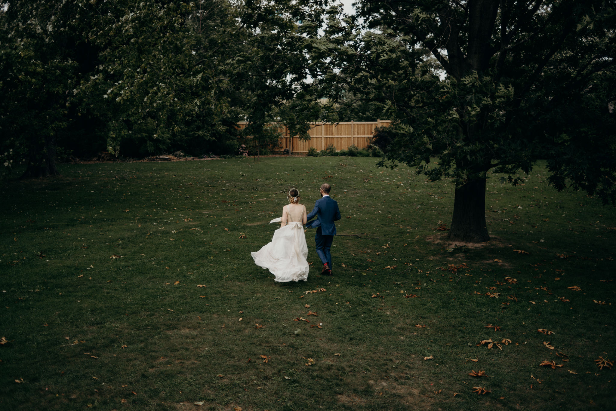 bride and groom walking on property at Spadina Museum