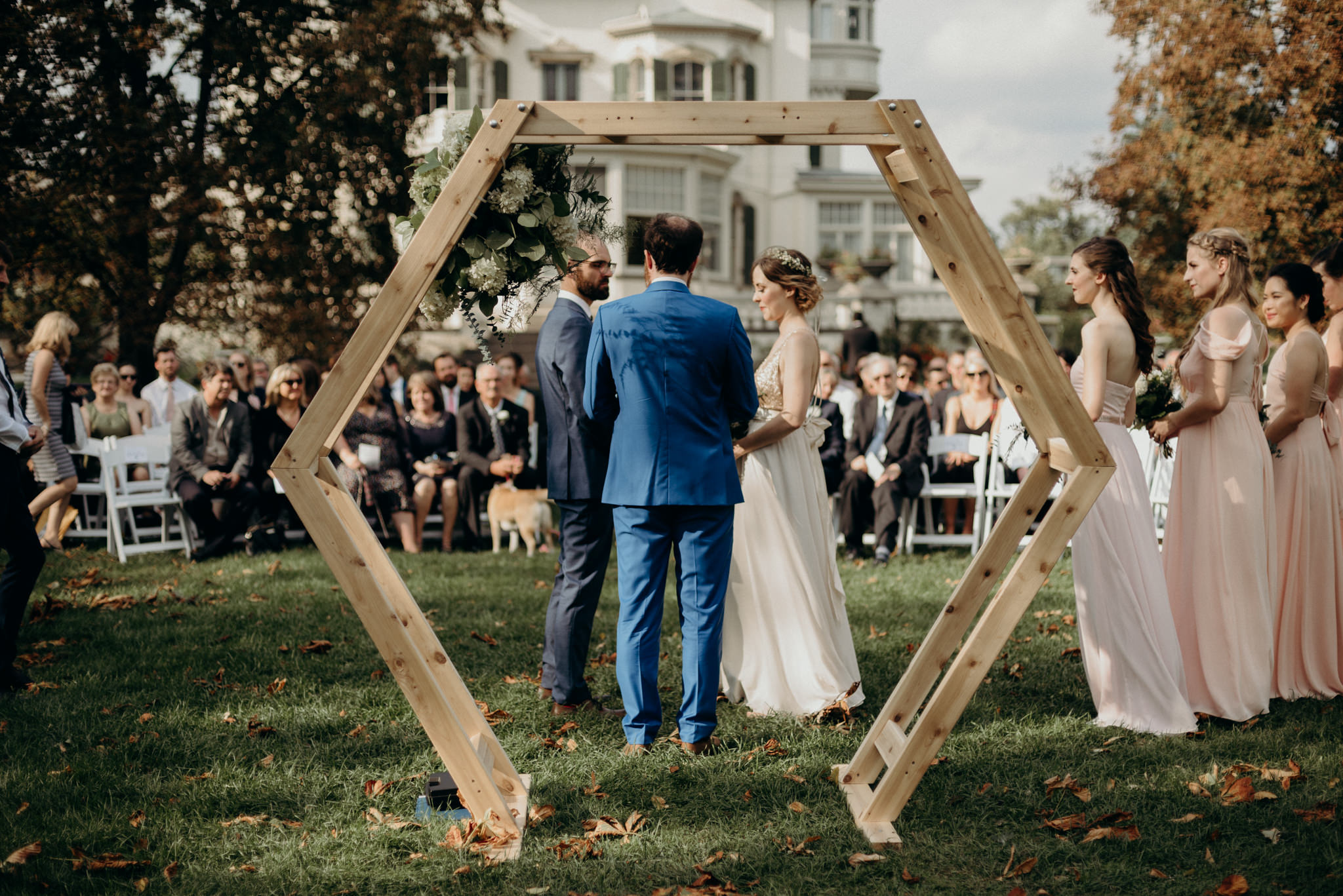 Wooden hexagon ceremony backdrop for outdoor wedding ceremony
