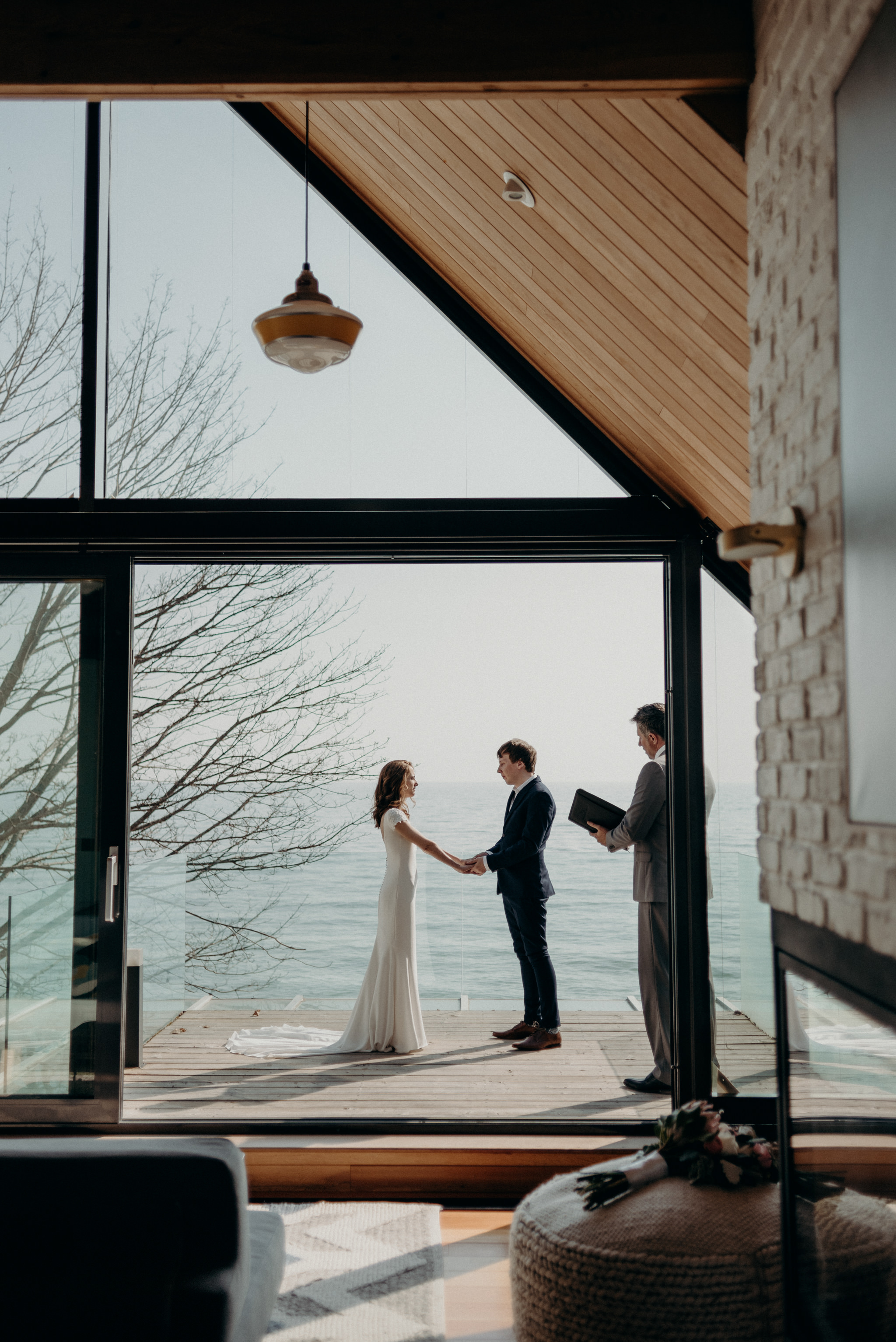 Bride and groom eloping on patio of owner's suite at Drake Devonshire Inn