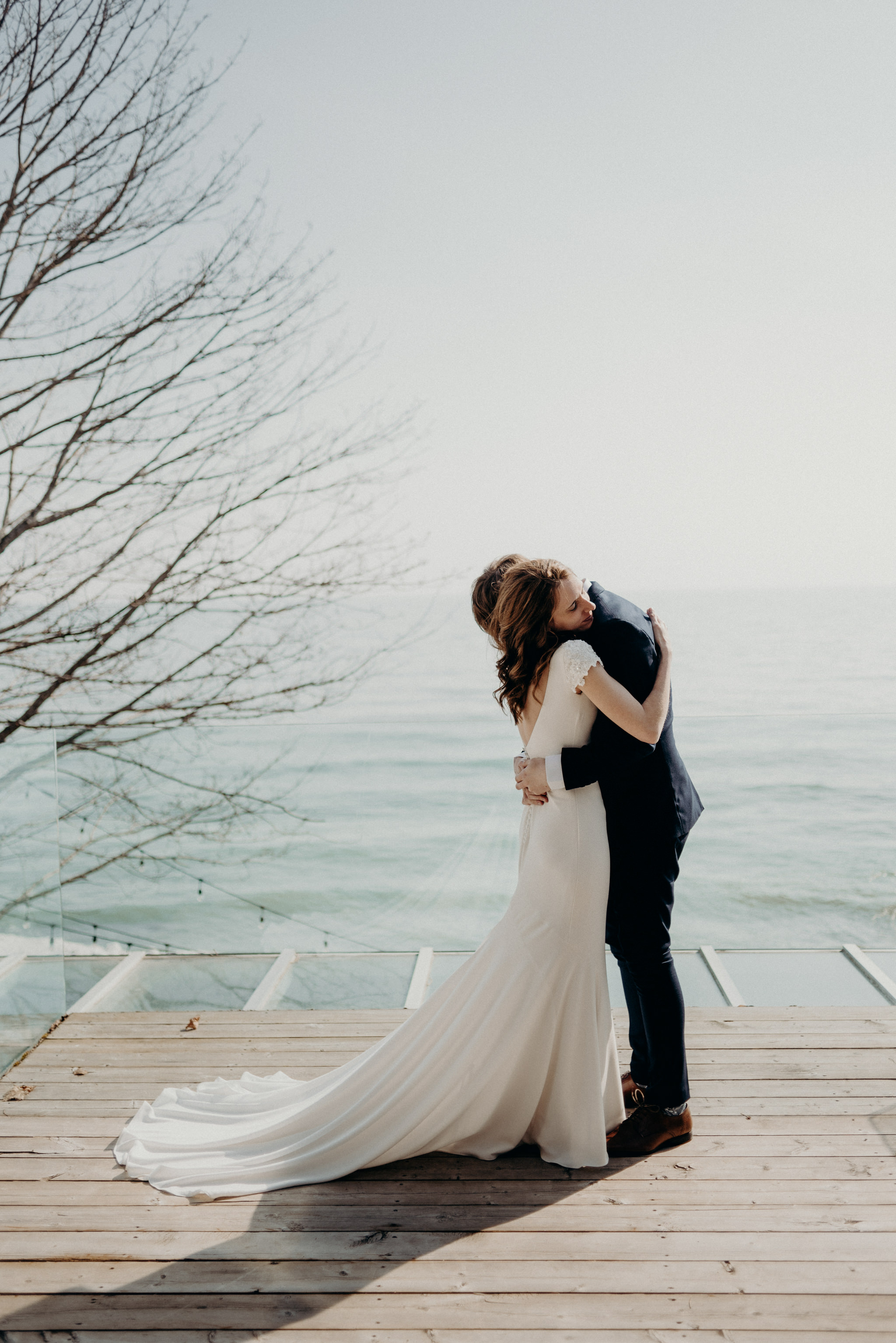 wedding ceremony on patio overlooking Lake Ontario at Drake Devonshire