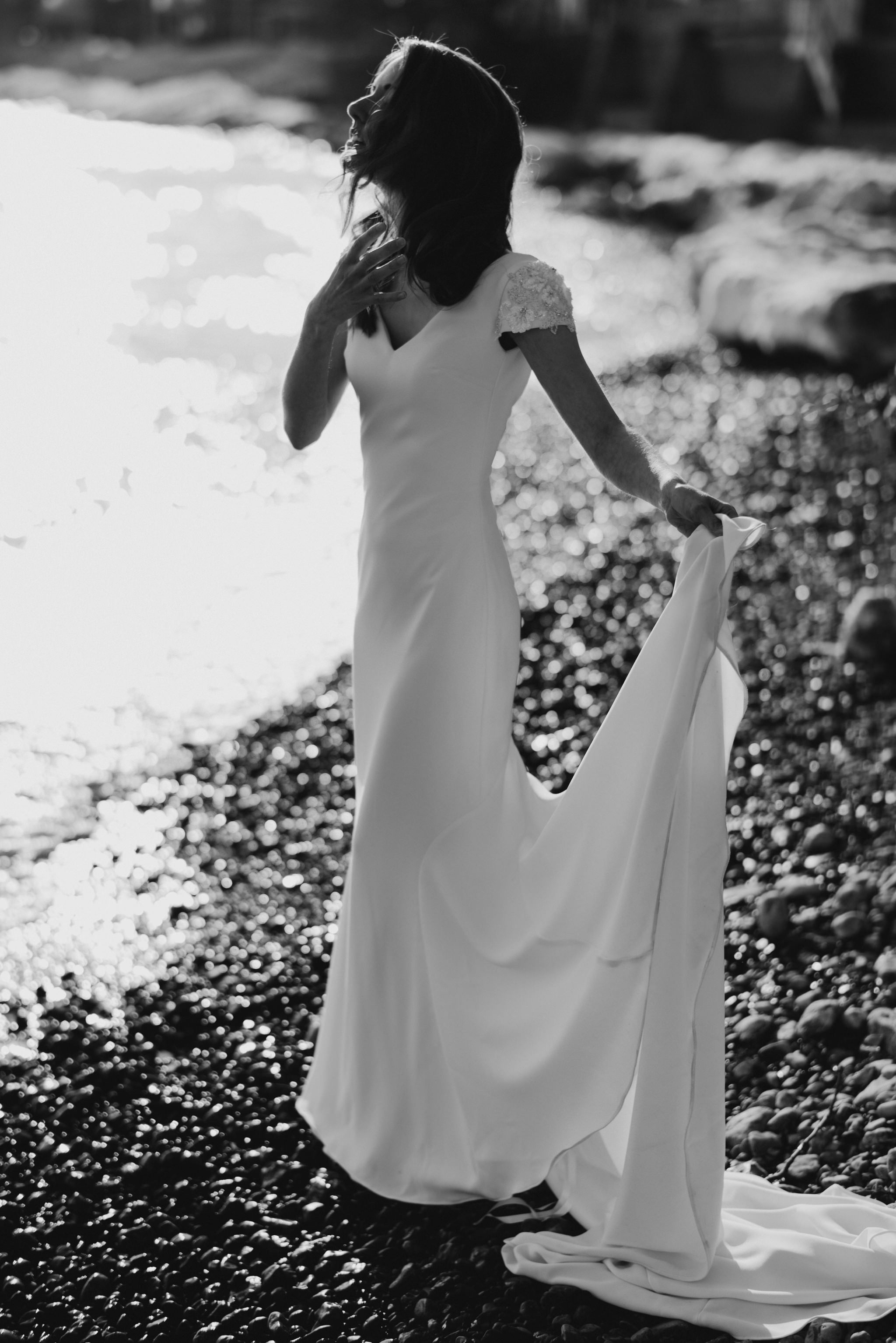 bride on beach at sunset