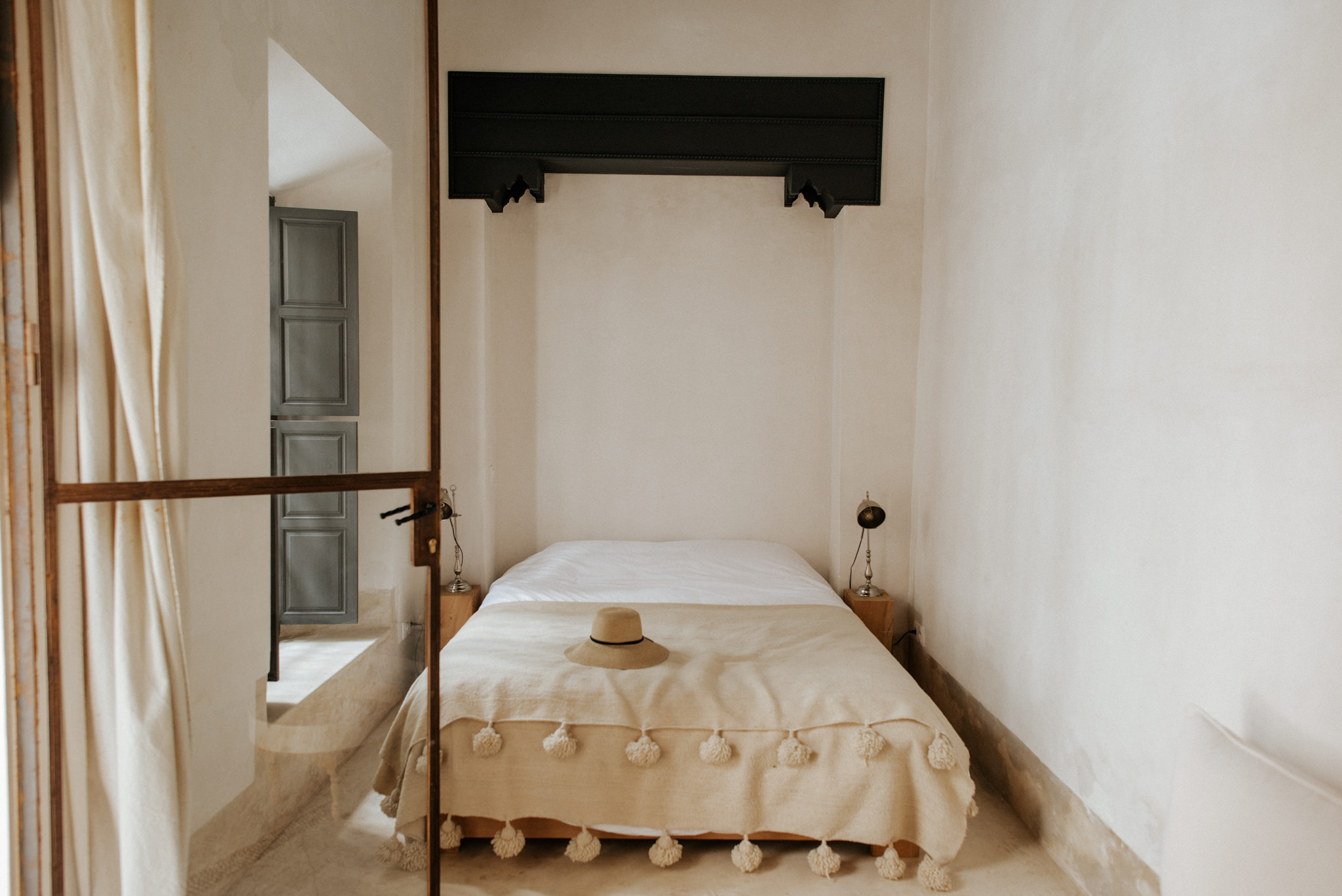 Clean minimalist bedroom at Riad 42 in Marrakech