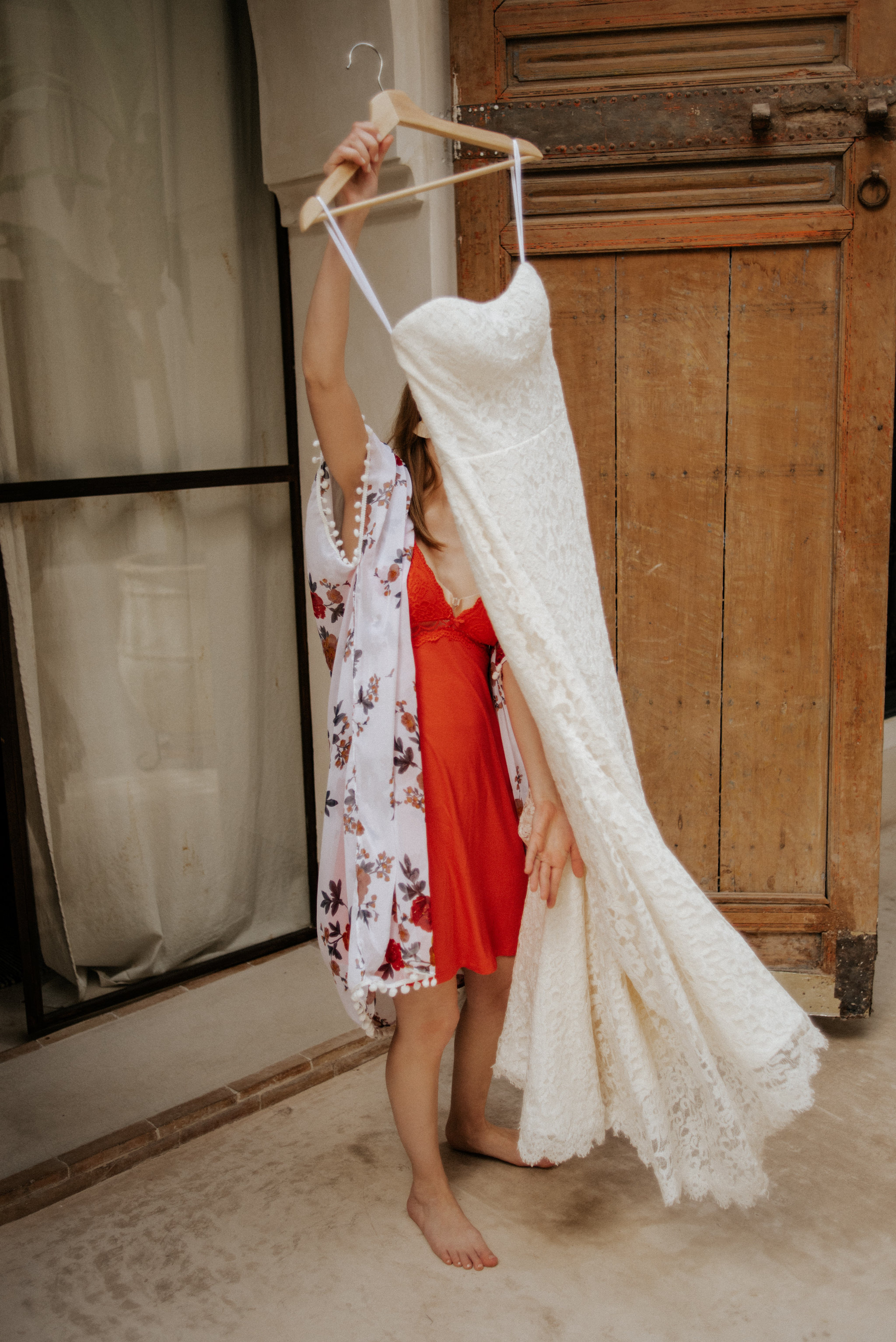 Bride holding dress, about to get ready for Morocco elopement