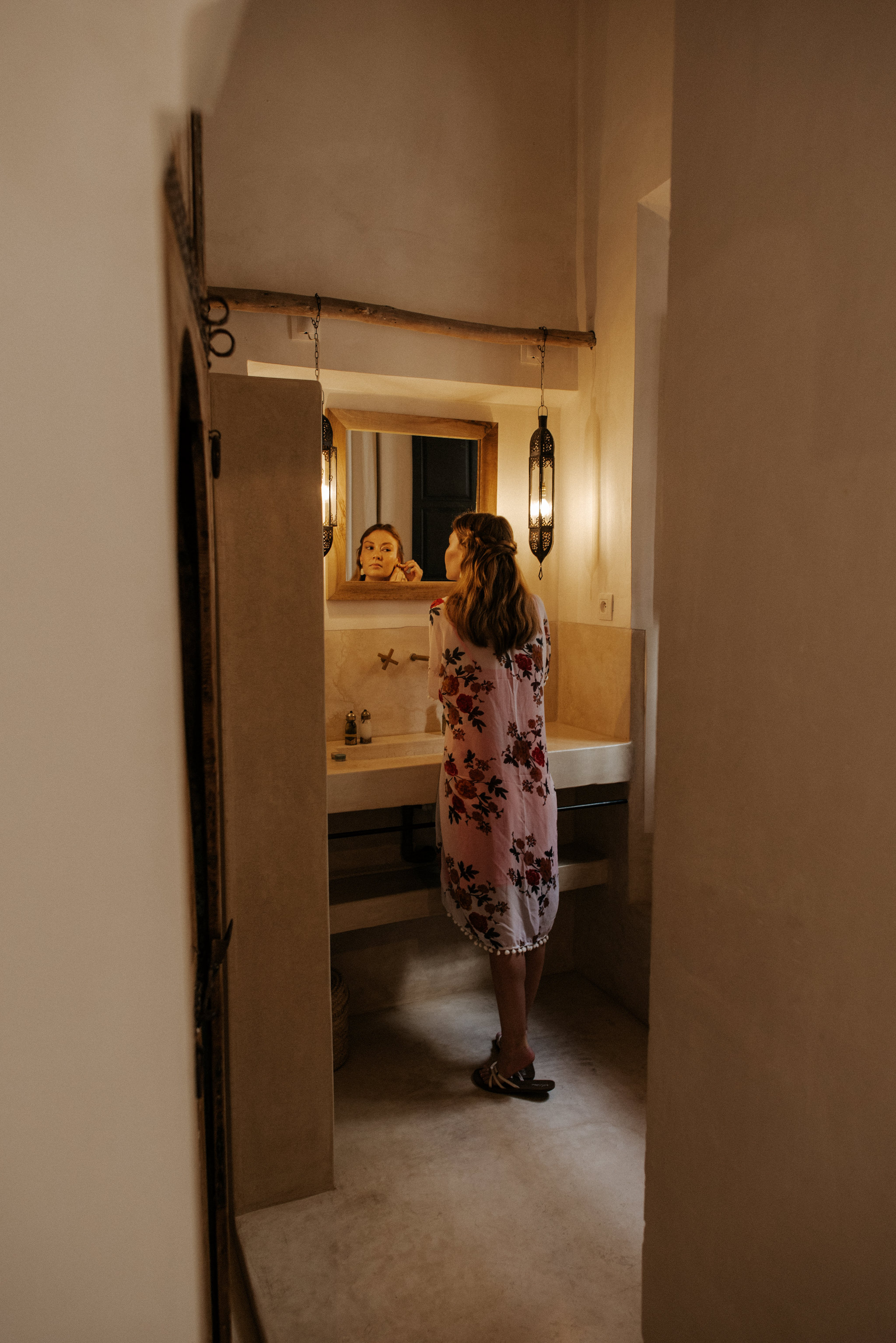 Bride getting ready in bathroom at Riad 42 for intimate Morocco elopement