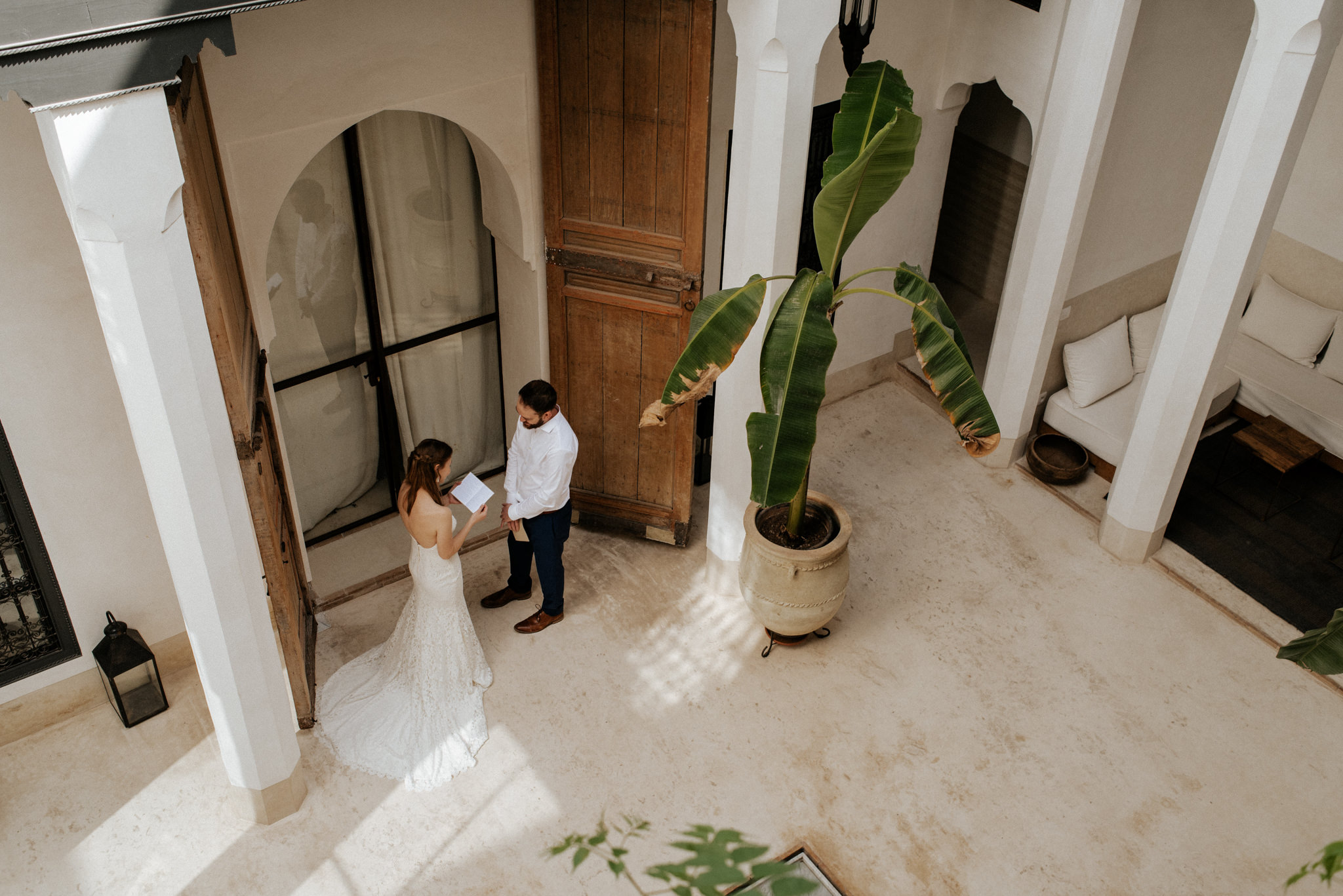 Bride and groom exchanging vows at Morocco elopement at Riad 42