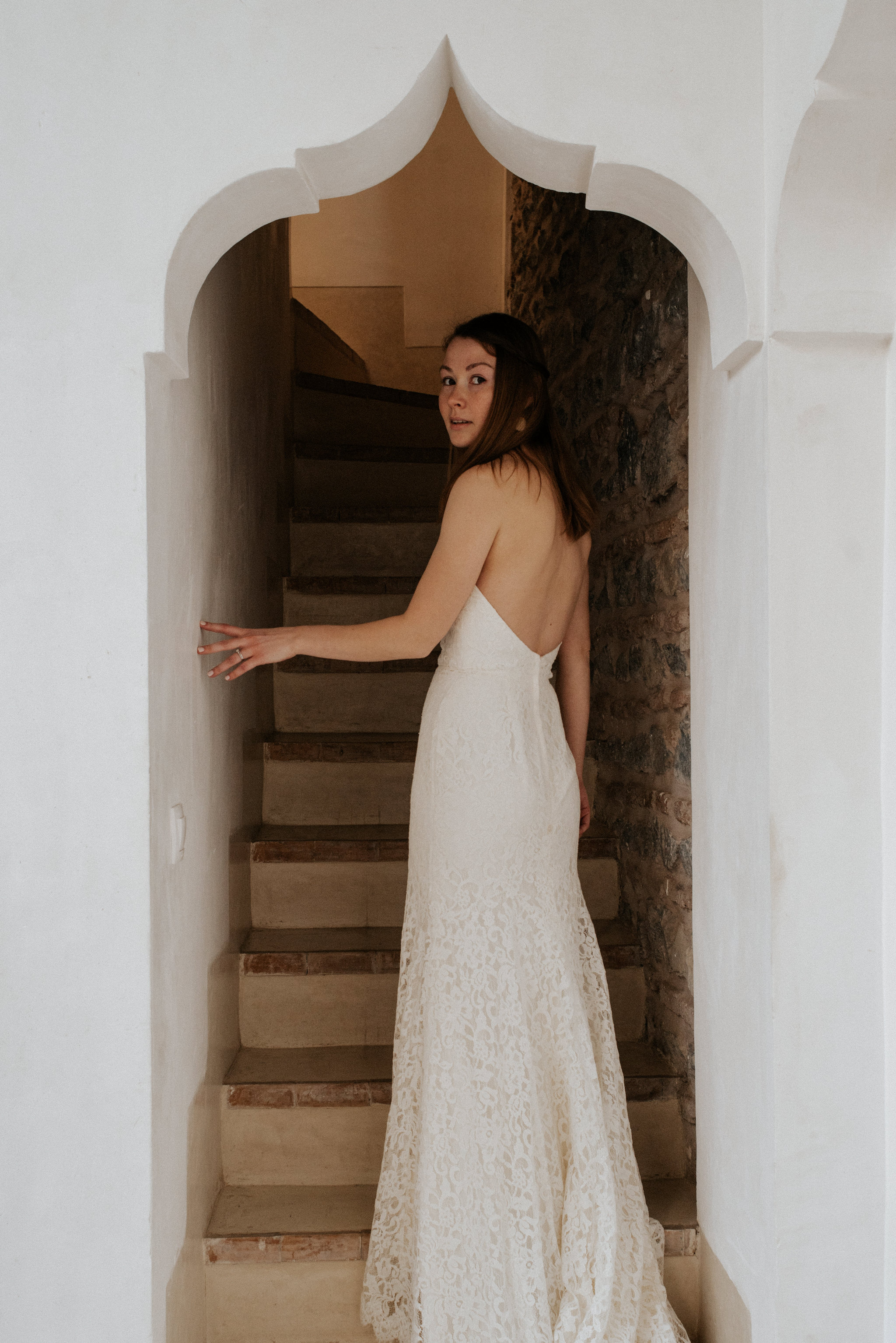 Bride standing in detailed archway at Moroccan riad 42