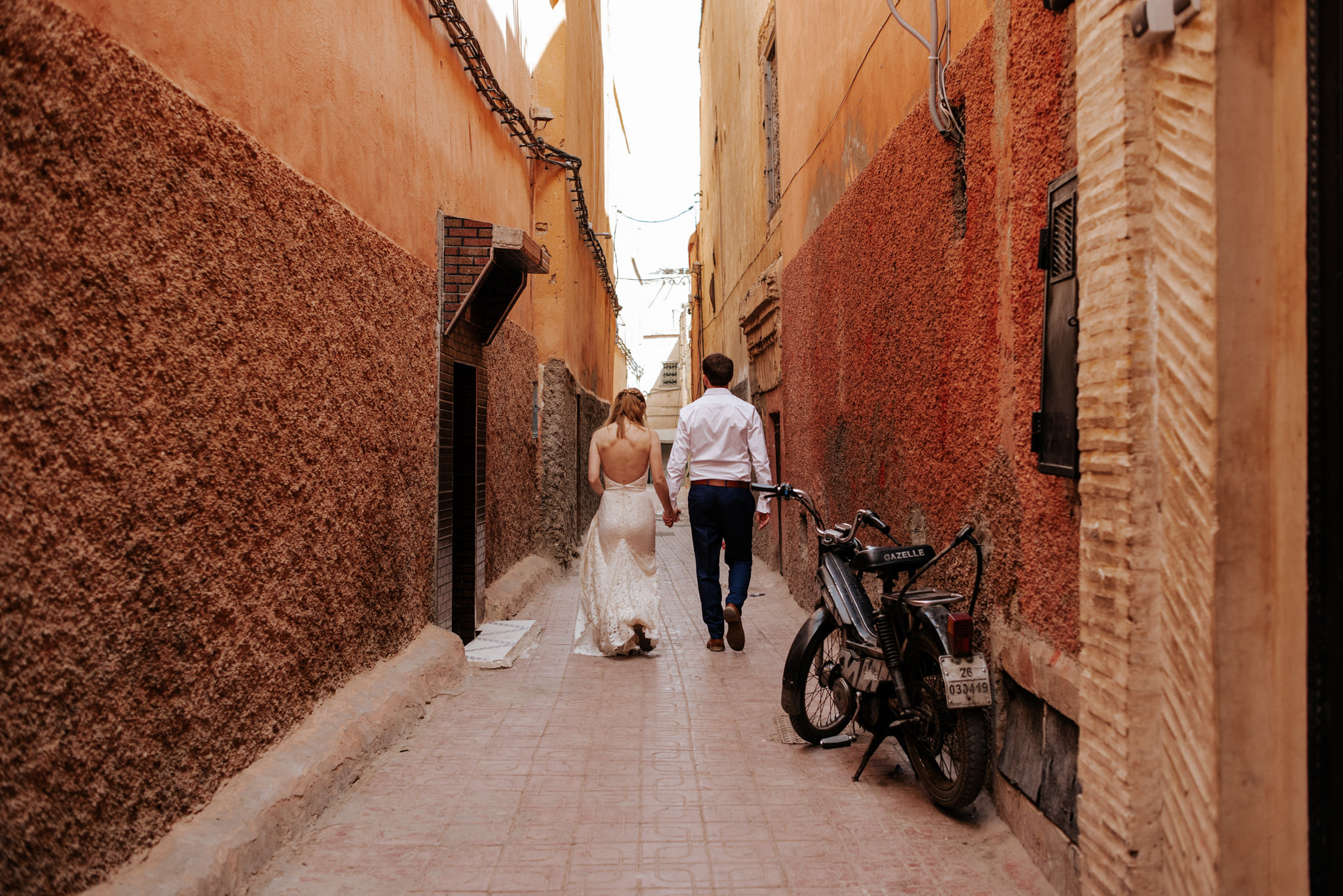 Bride and groom walking in the medina in Marrakech for their Morocco elopement