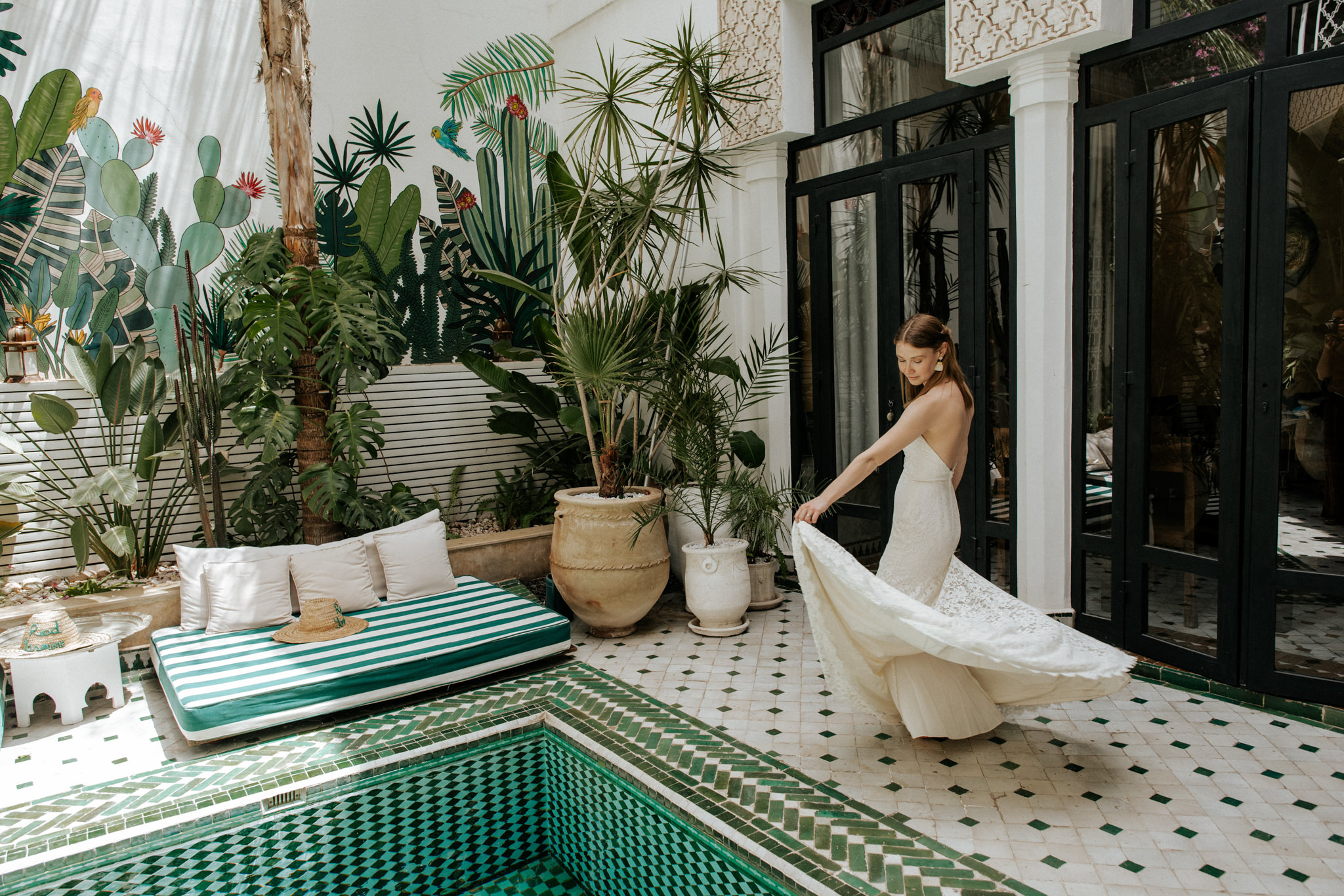 bride twirling dress in beautiful courtyard of Le Riad Yasmine